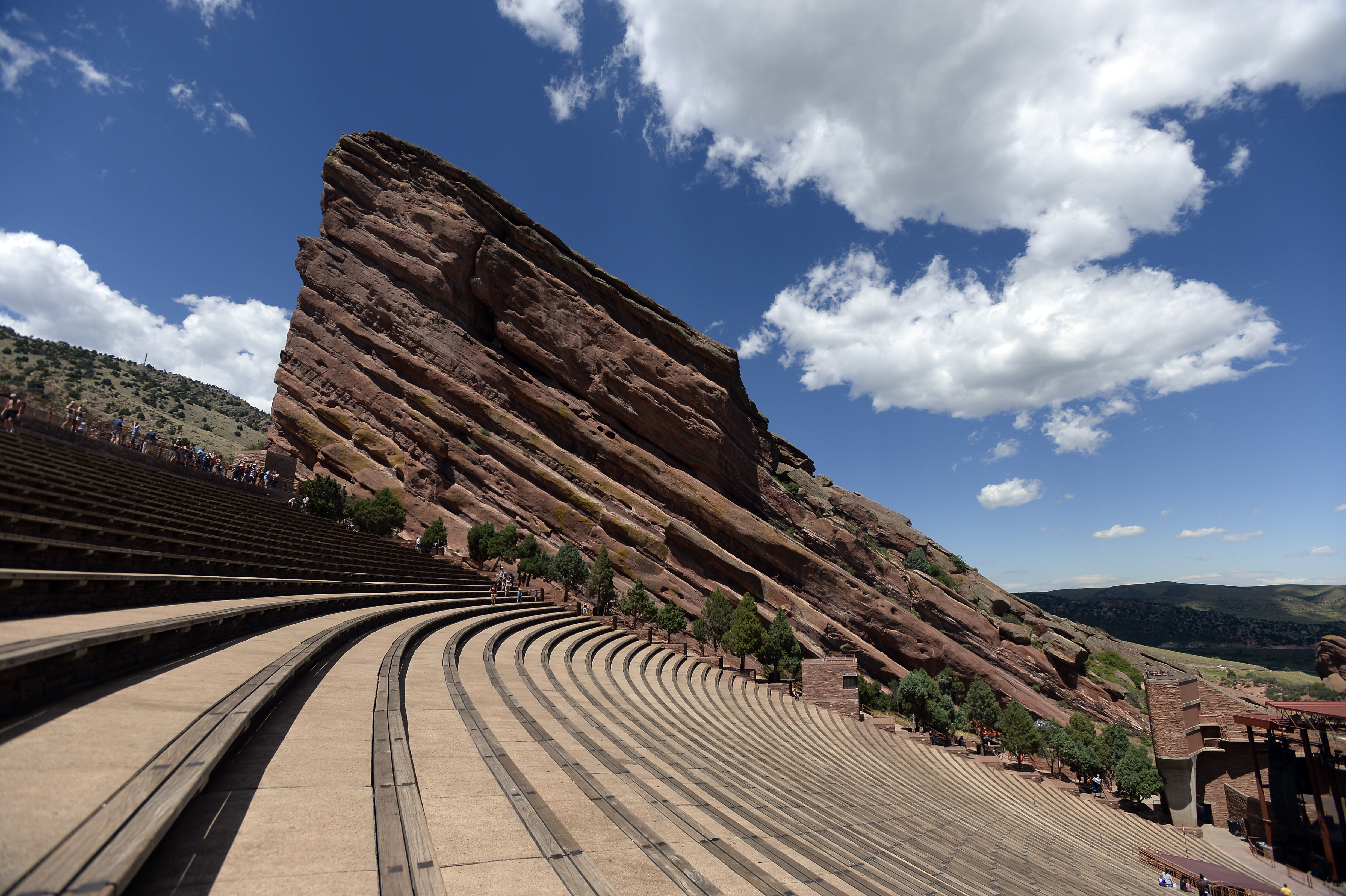 Visitors head to Red Rocks to get in a workout and to visit the rocks, Creation, Ship Rock and Stage Rock, on Aug 4, 2015, in Morrison, Colo.