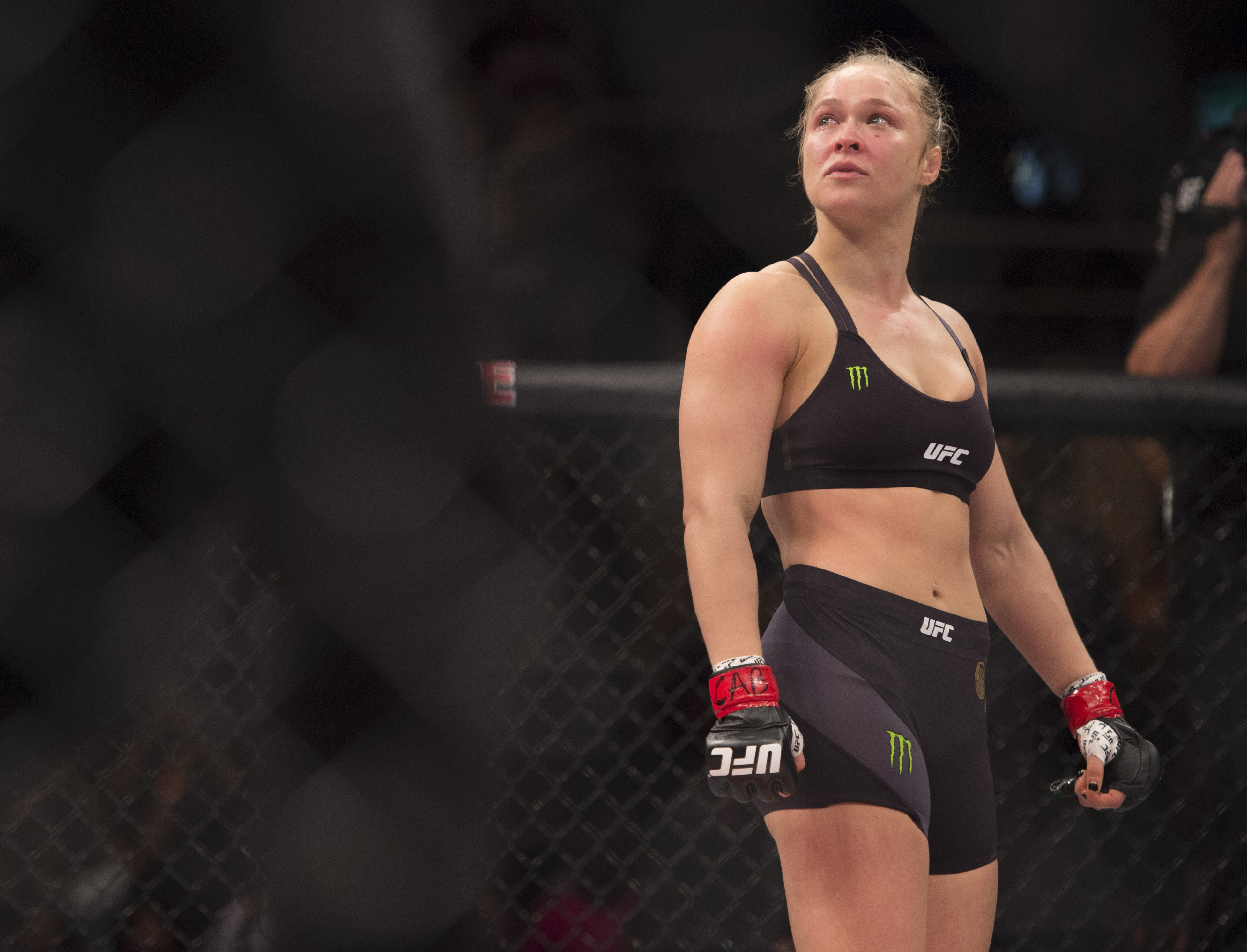 UFC women's bantamweight champion Ronda Rousey celebrates after defeating Bethe Correia of Brazil by KO during the UFC 190 event on August 1, 2015 in Rio de Janeiro.