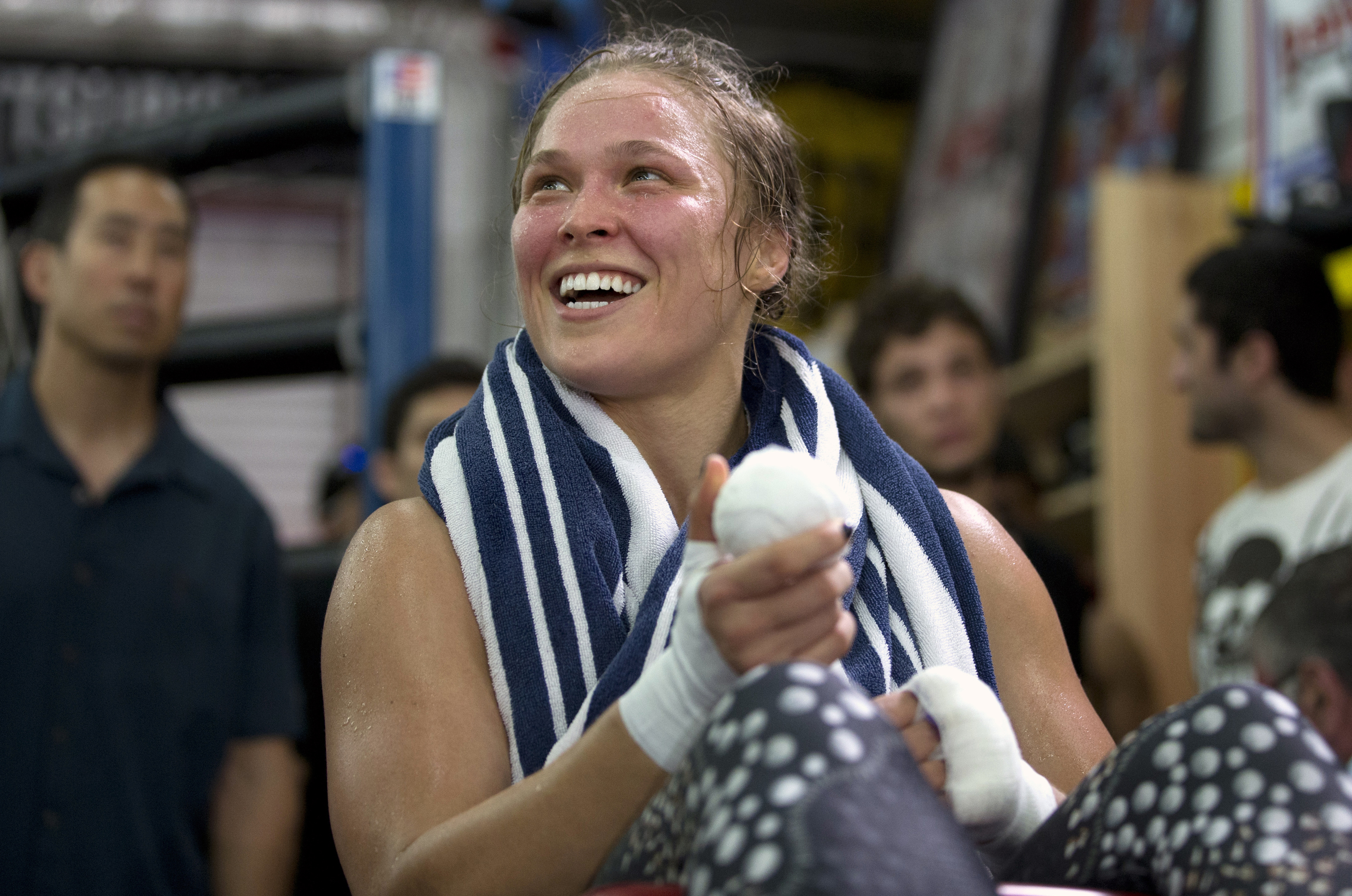 Mixed martial arts fighter Ronda Rousey smiles during her workout at Glendale Fighting Club, in Glendale, Calif. on July 15, 2015.
