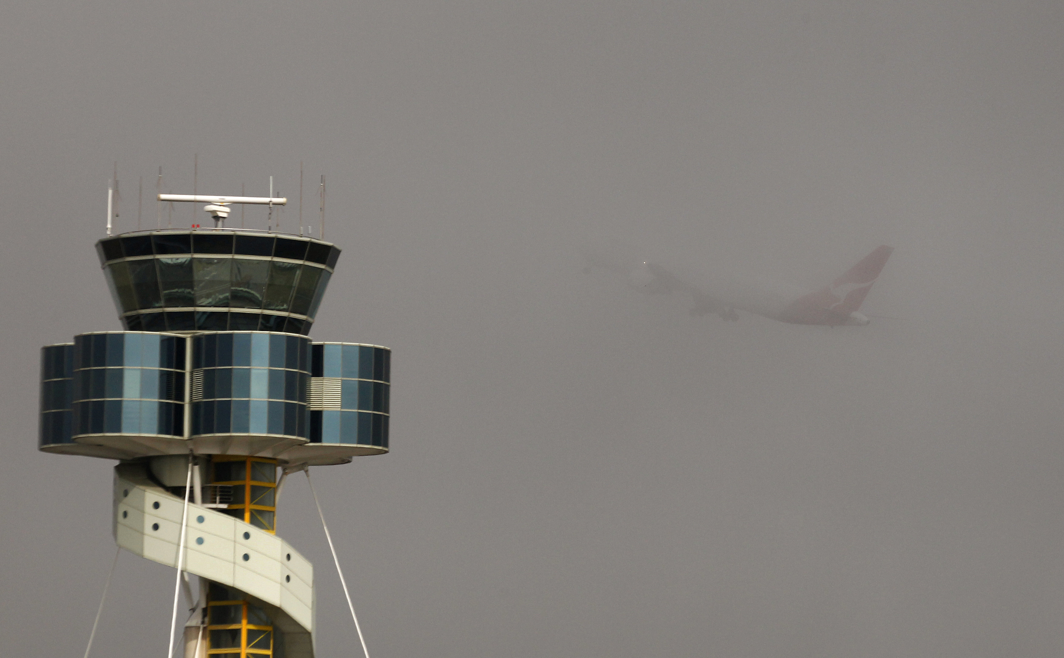 A Qantas plane takes off from Sydney airport amidst thick fog on May 29, 2013.