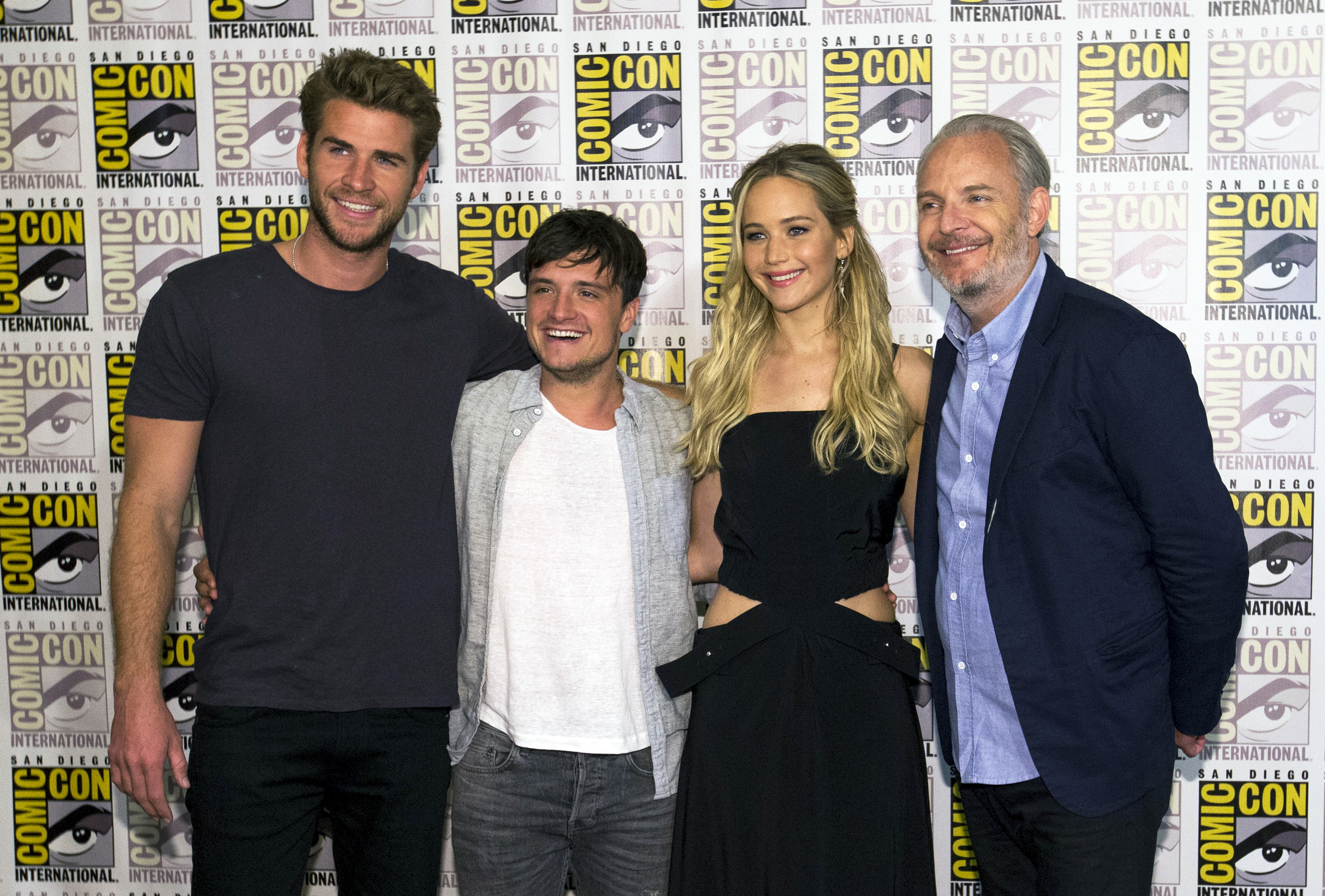 Director of <i>The Hunger Games: Mockingjay - Part 1 &amp; 2</i> Francis Lawrence poses with cast members Jennifer Lawrence, Josh Hutcherson and Liam Hemsworth during the 2015 Comic-Con International Convention on July 9, 2015 in San Diego, Calif.
