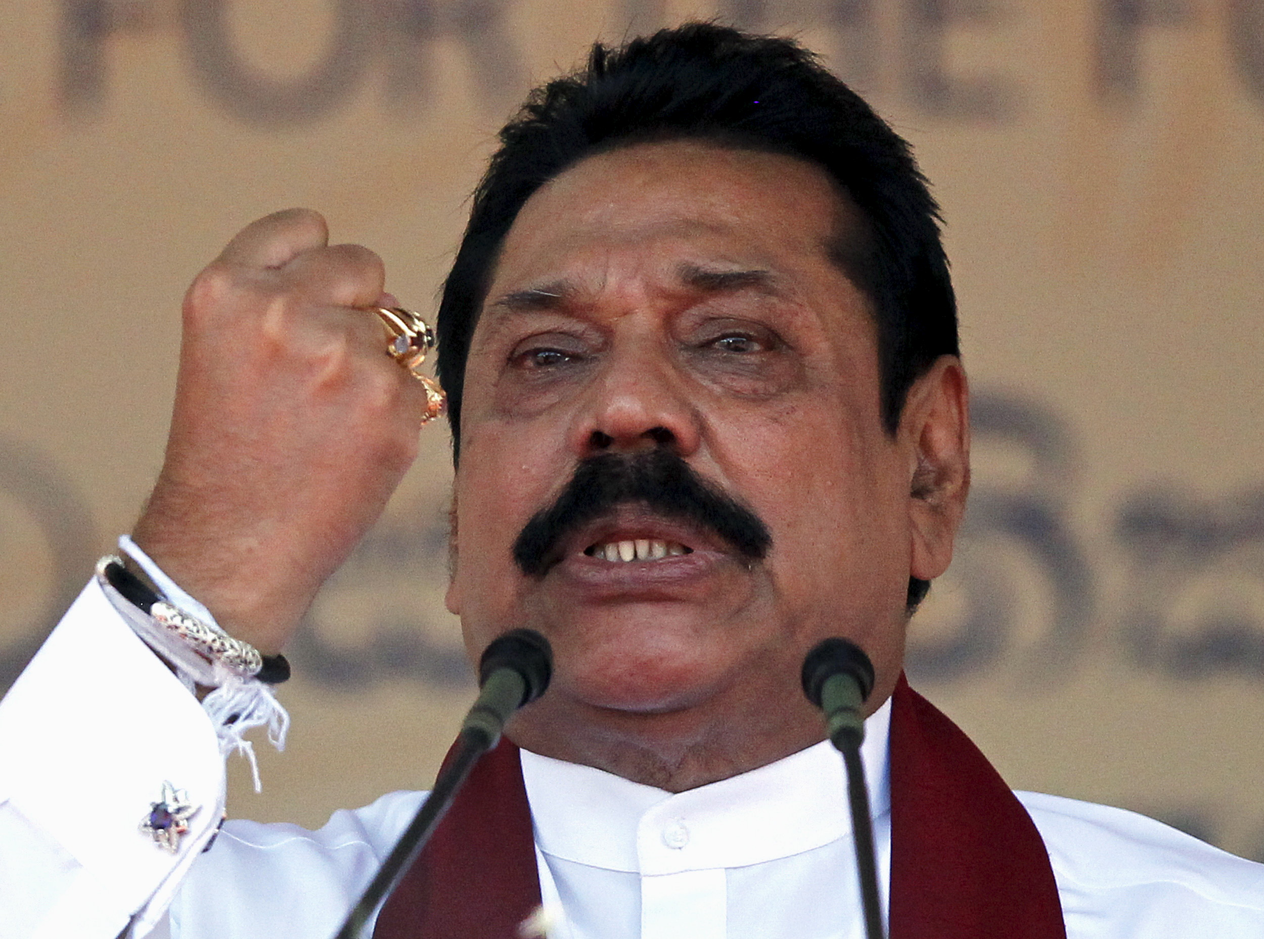 Sri Lanka's former president Mahinda Rajapaksa, who is contesting in the upcoming general election, speaks during the launch ceremony of his manifesto, in Colombo July 28, 2015