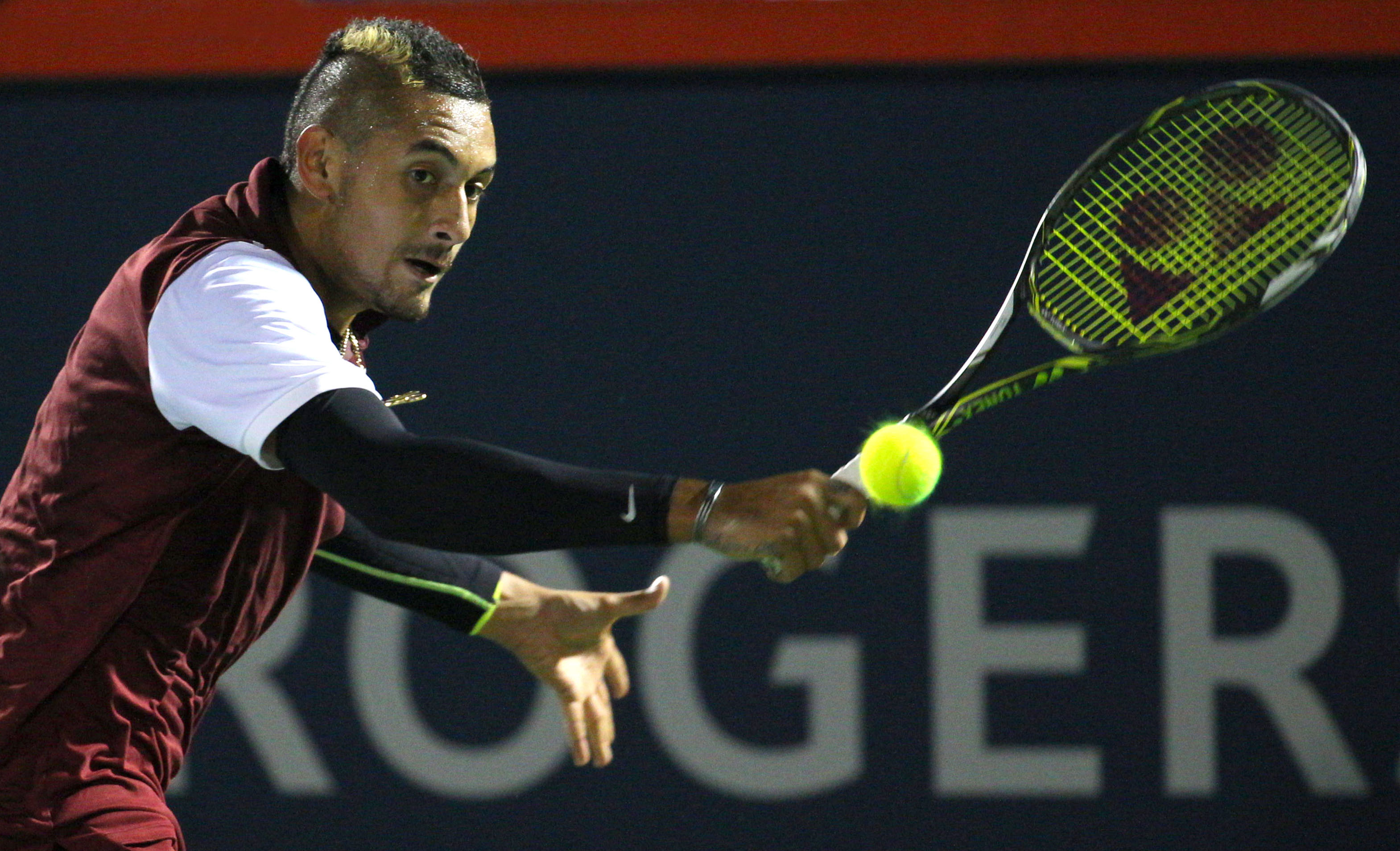 Nick Kyrgios of Australia hits a shot against Stan Wawrinka of Switzerland during the Rogers Cup tennis tournament in Montreal, Quebec, Canada on August 12, 2015.