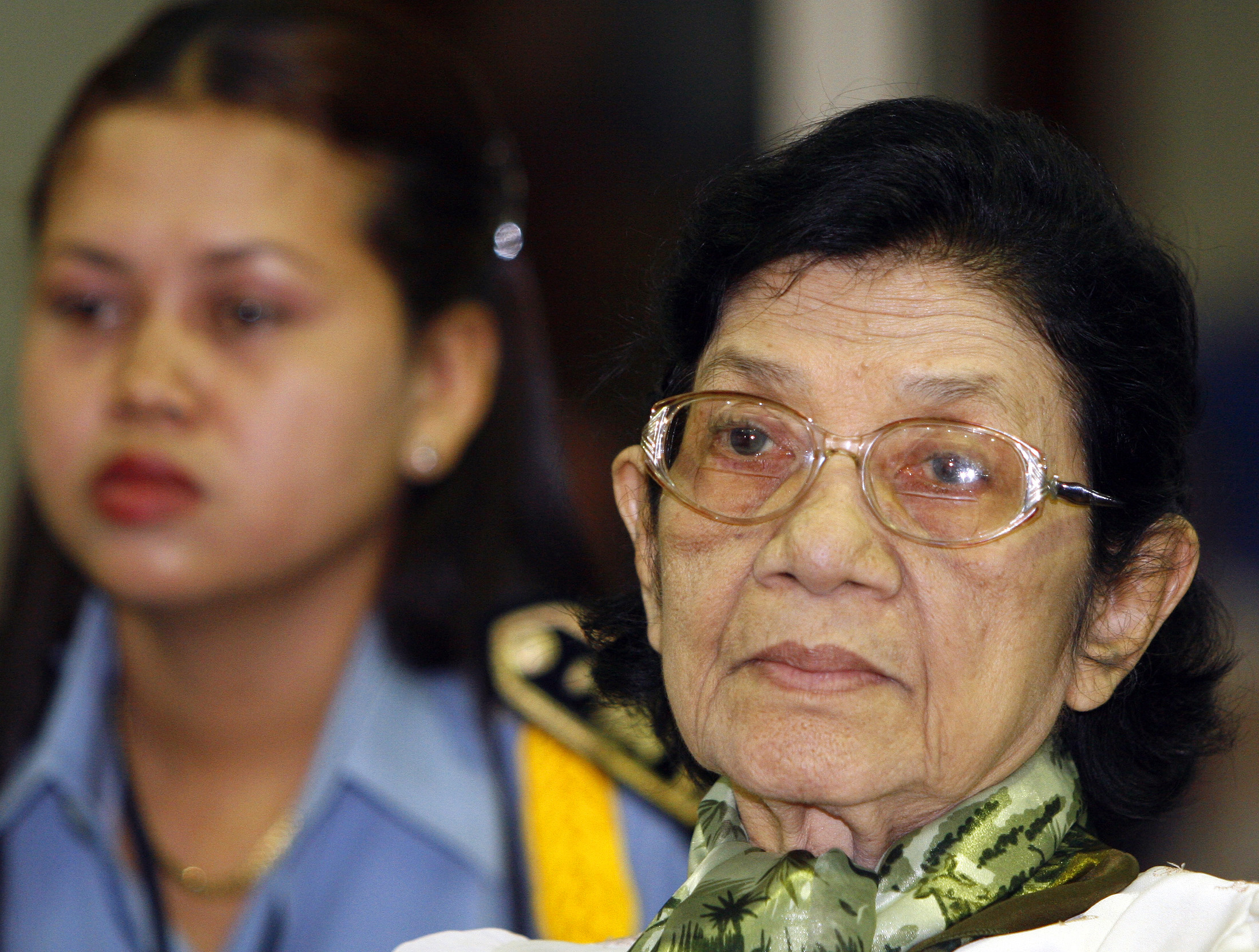 Ieng Thirith, Social Affairs Minister under the Khmer Rouge regime, sits in the dock during her pretrial chamber public hearing at Extraordinary Chambers in the Courts of Cambodia, on the outskirts of Phnom Penh on Feb. 24, 2009