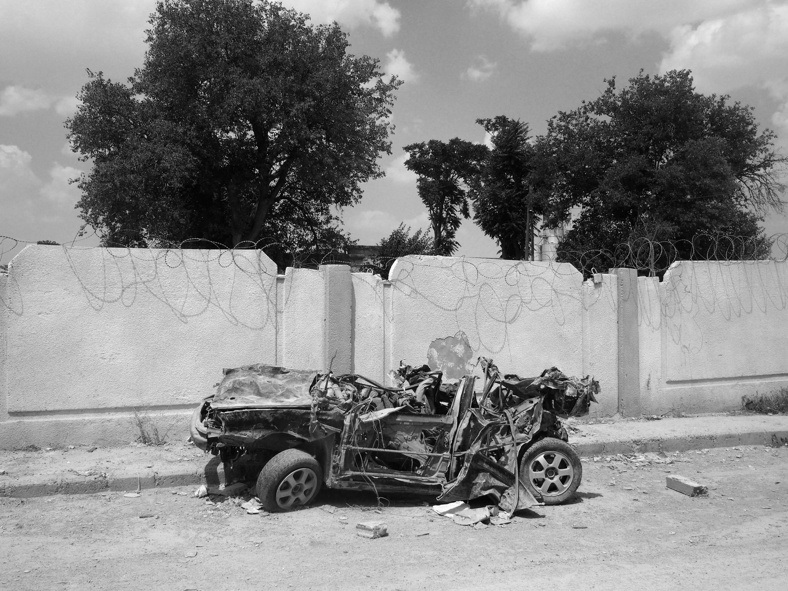 A car damaged during the fighting in the Kurdish-held city of Kobani, Syria. Aug. 8, 2015.