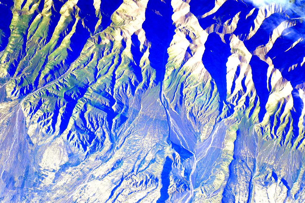 I love the color green on these mountains in #China. Not much green here on @Space_Station. #YearInSpace  - via Twitter on Aug. 8, 2015