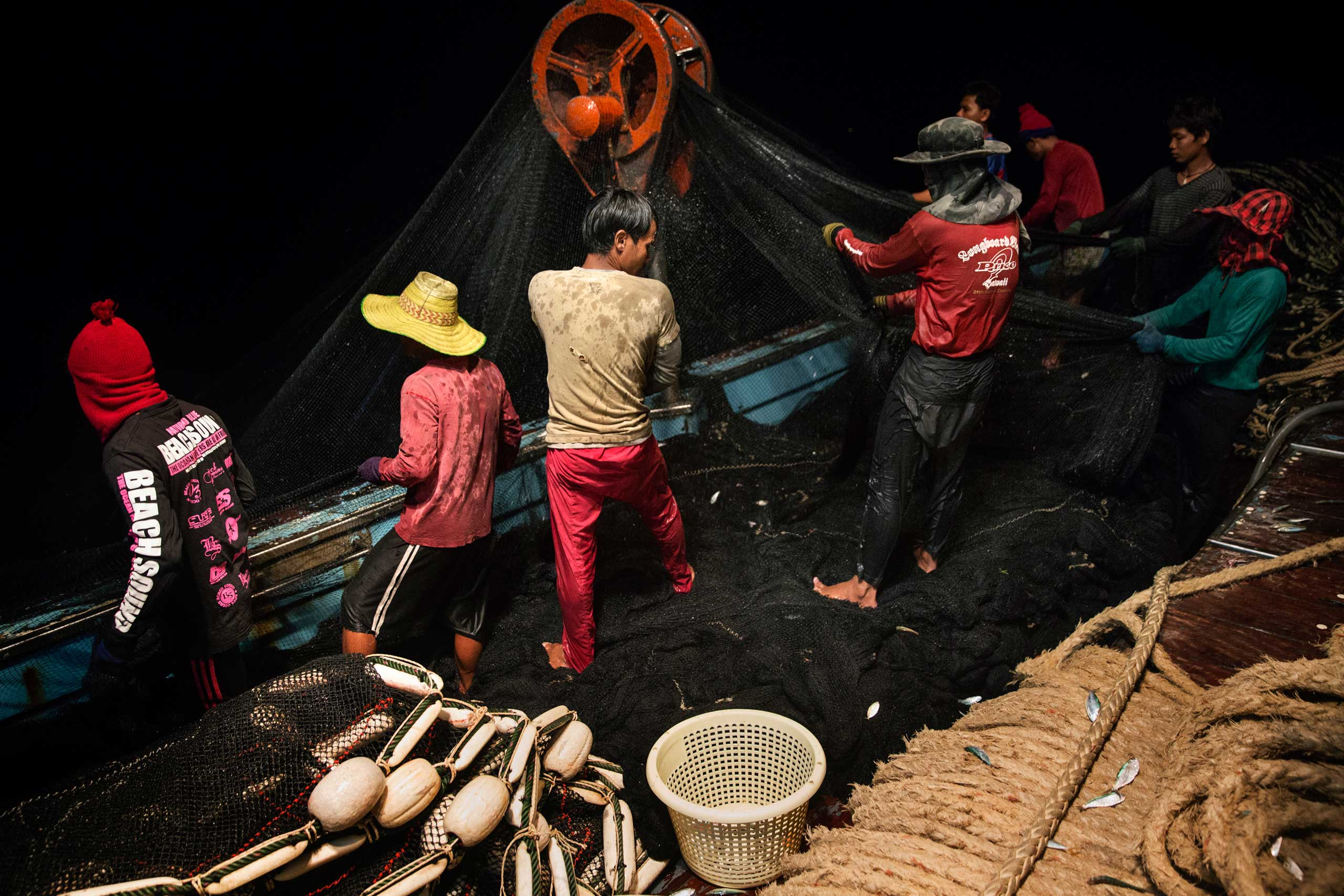 The New York Times Lens blog: Life Among the Sea Slaves                               Cambodian migrant fishermen haul in the net on a Thai flagged fishing boat in the Gulf of Thailand.