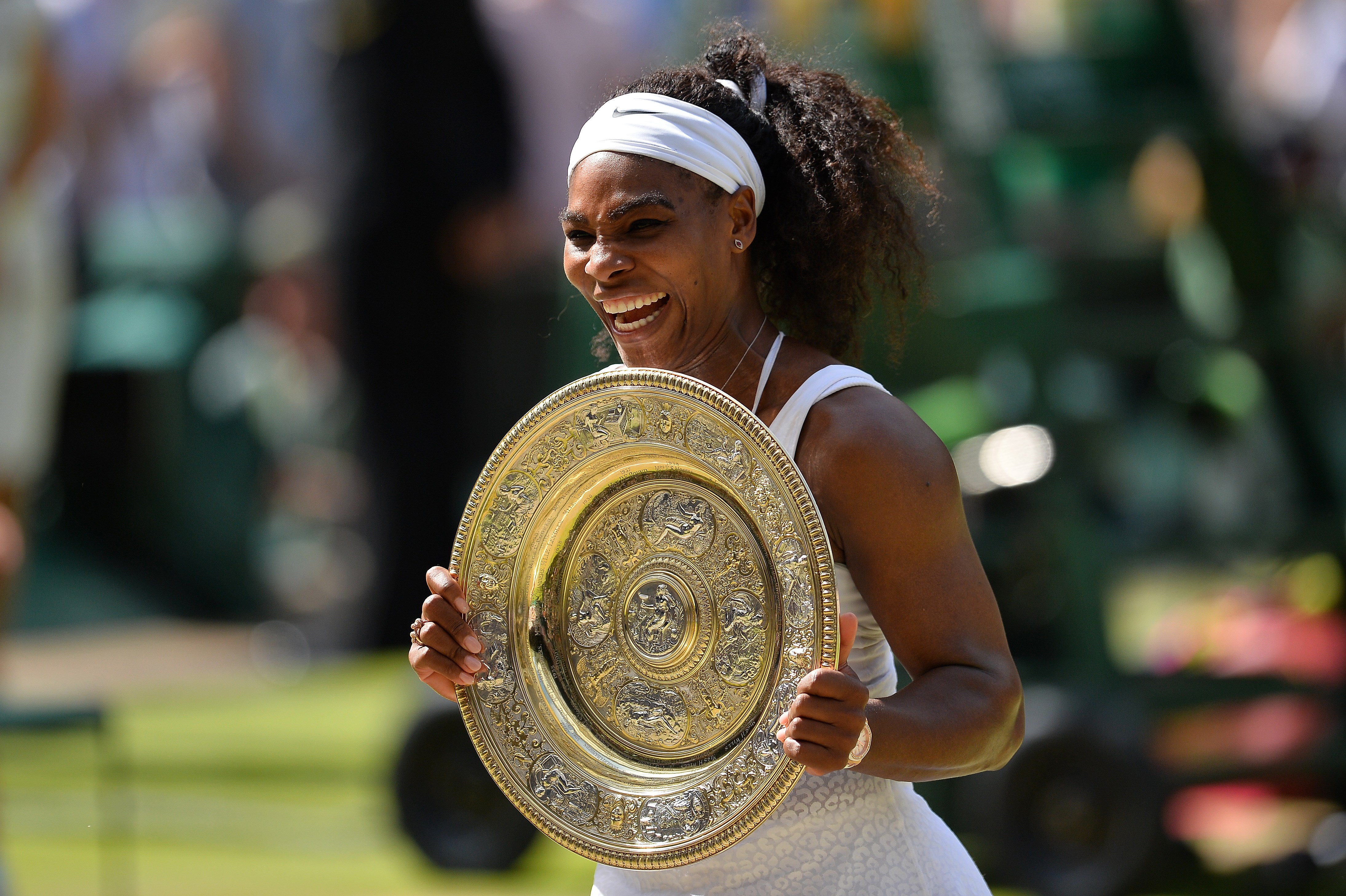 Serena Williams celebrates with the winner's trophy after her women's singles final victory over Spain's Garbine Muguruza at the 2015 Wimbledon Championships in London, on July 11, 2015.