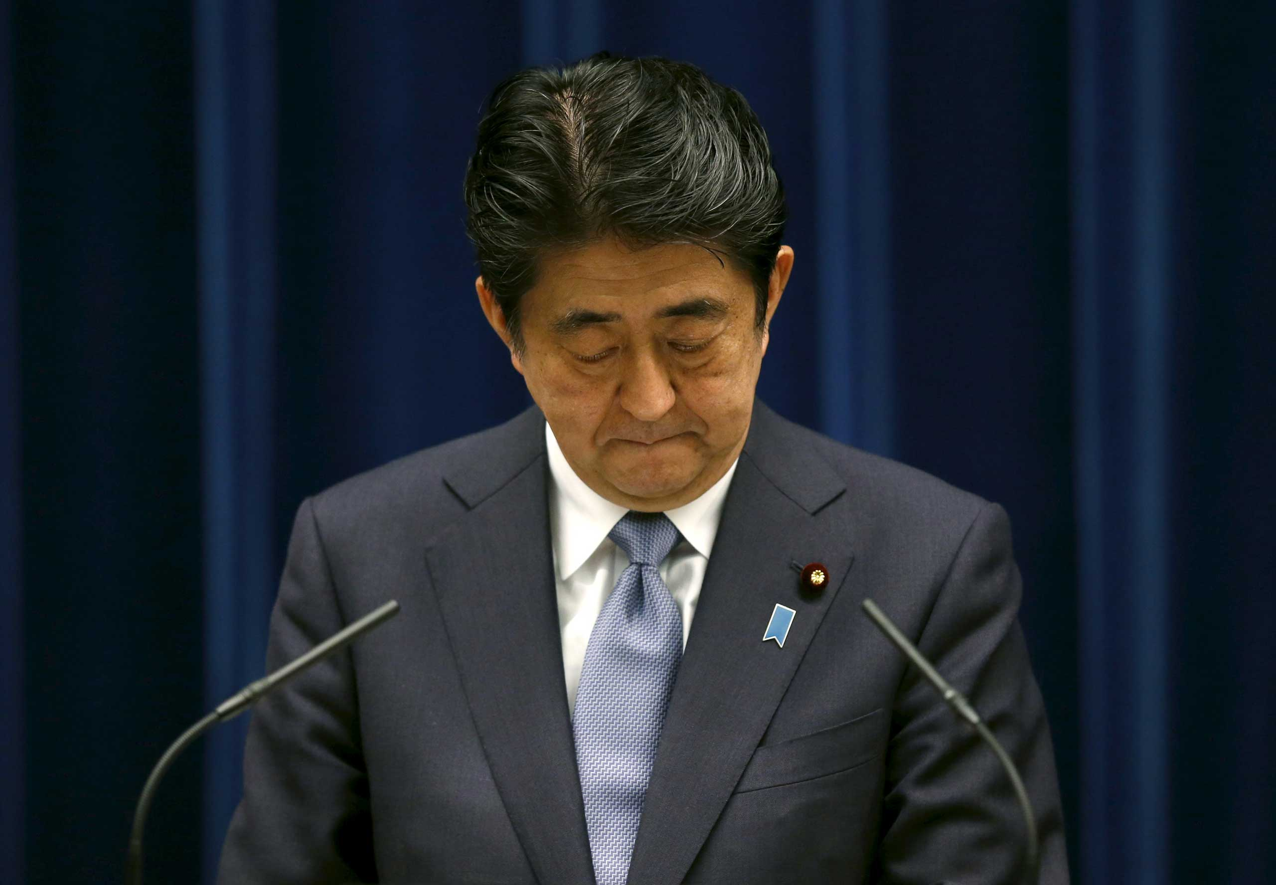 Japan's Prime Minister Shinzo Abe attends a news conference to deliver a statement marking the 70th anniversary of World War Two's end, at his official residence in Tokyo Aug. 14, 2015.