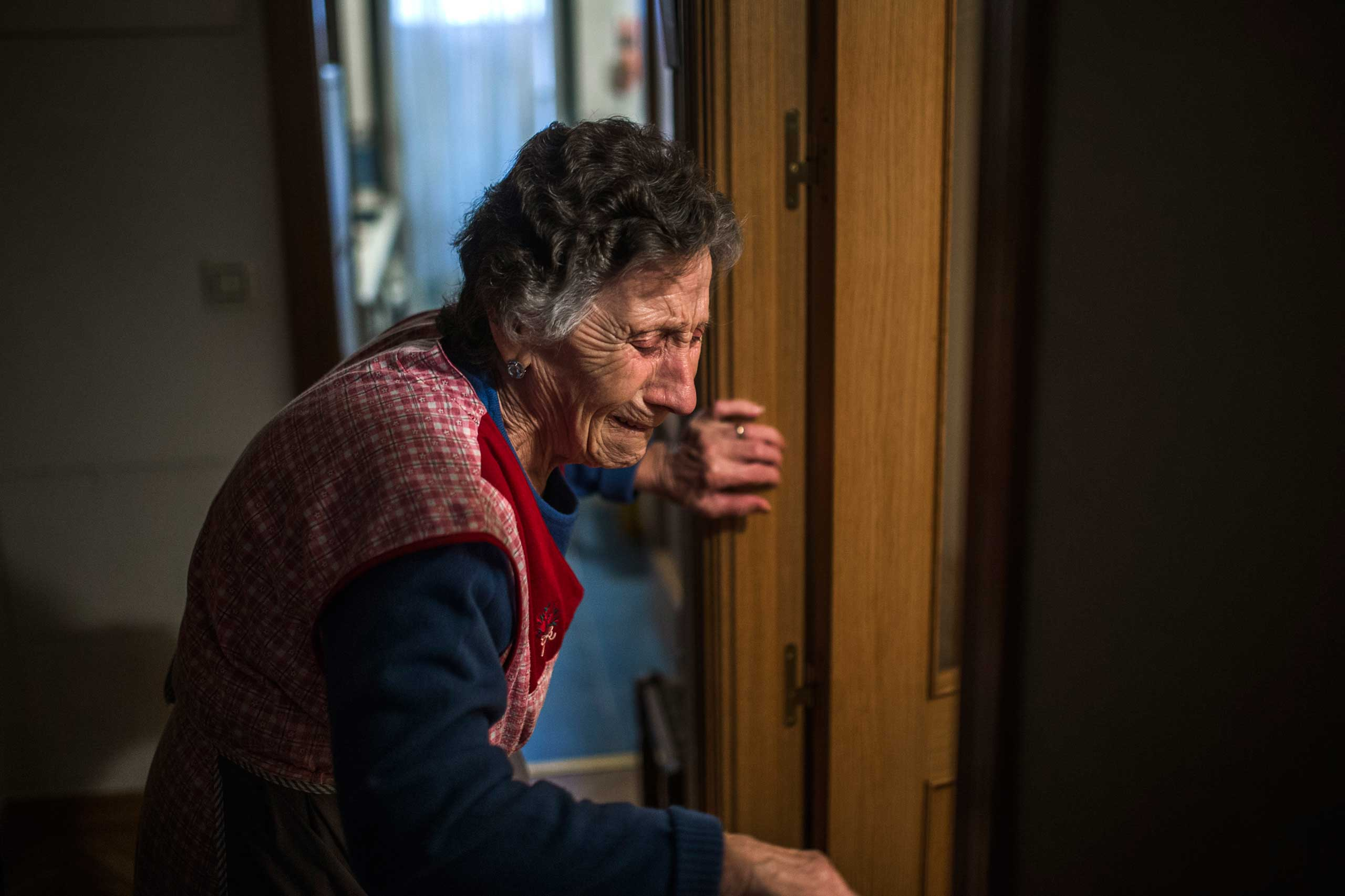 Carmen Martinez Ayuso, 85, cries during her eviction in Madrid. Nov. 2014.