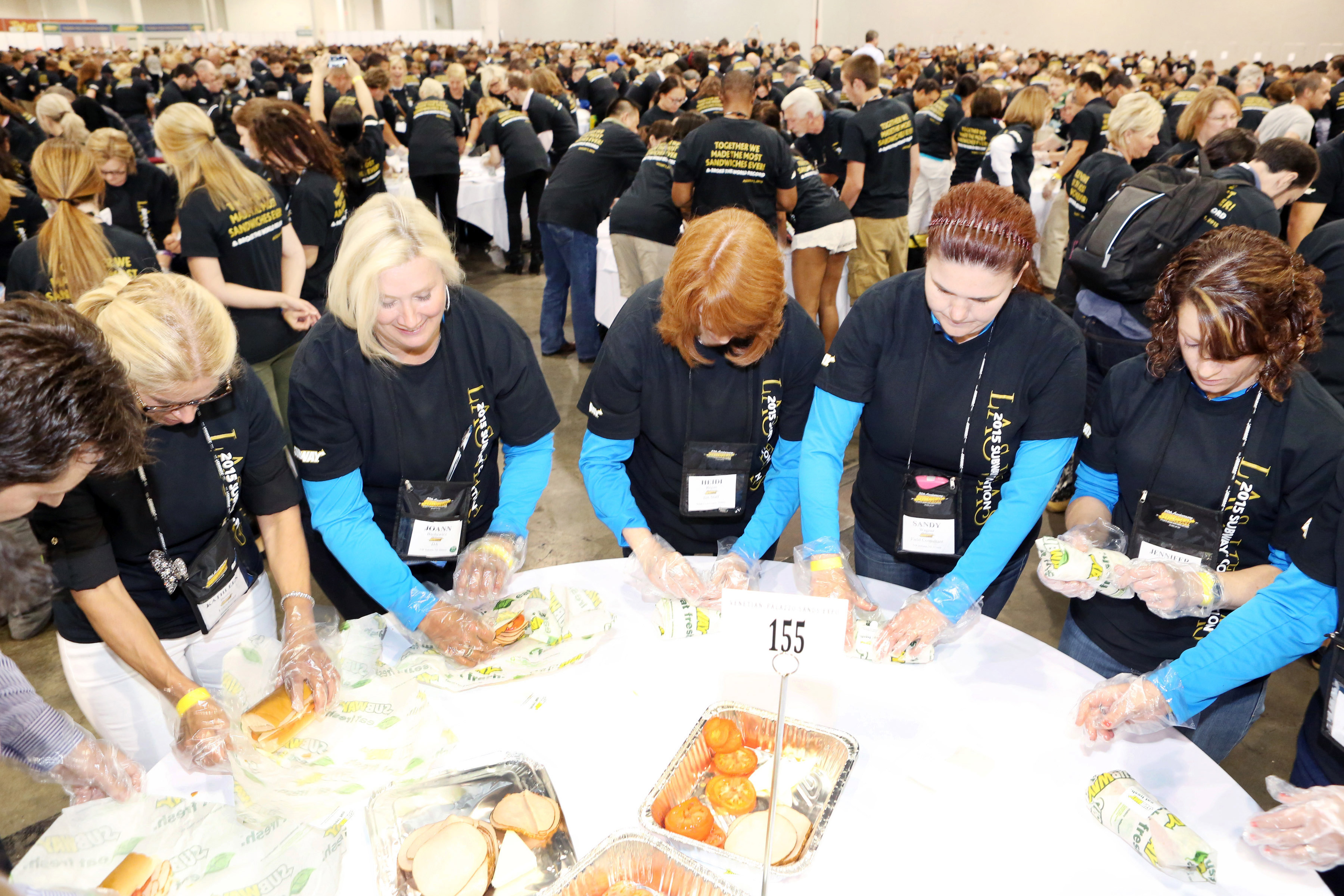 Sandwich-makers set a new Guinness World Record for most people making sandwiches simultaneously with 1,481 people during an event held at The Venetian Resort Hotel Casino on Aug. 1, 2015, in Las Vegas, Nevada.