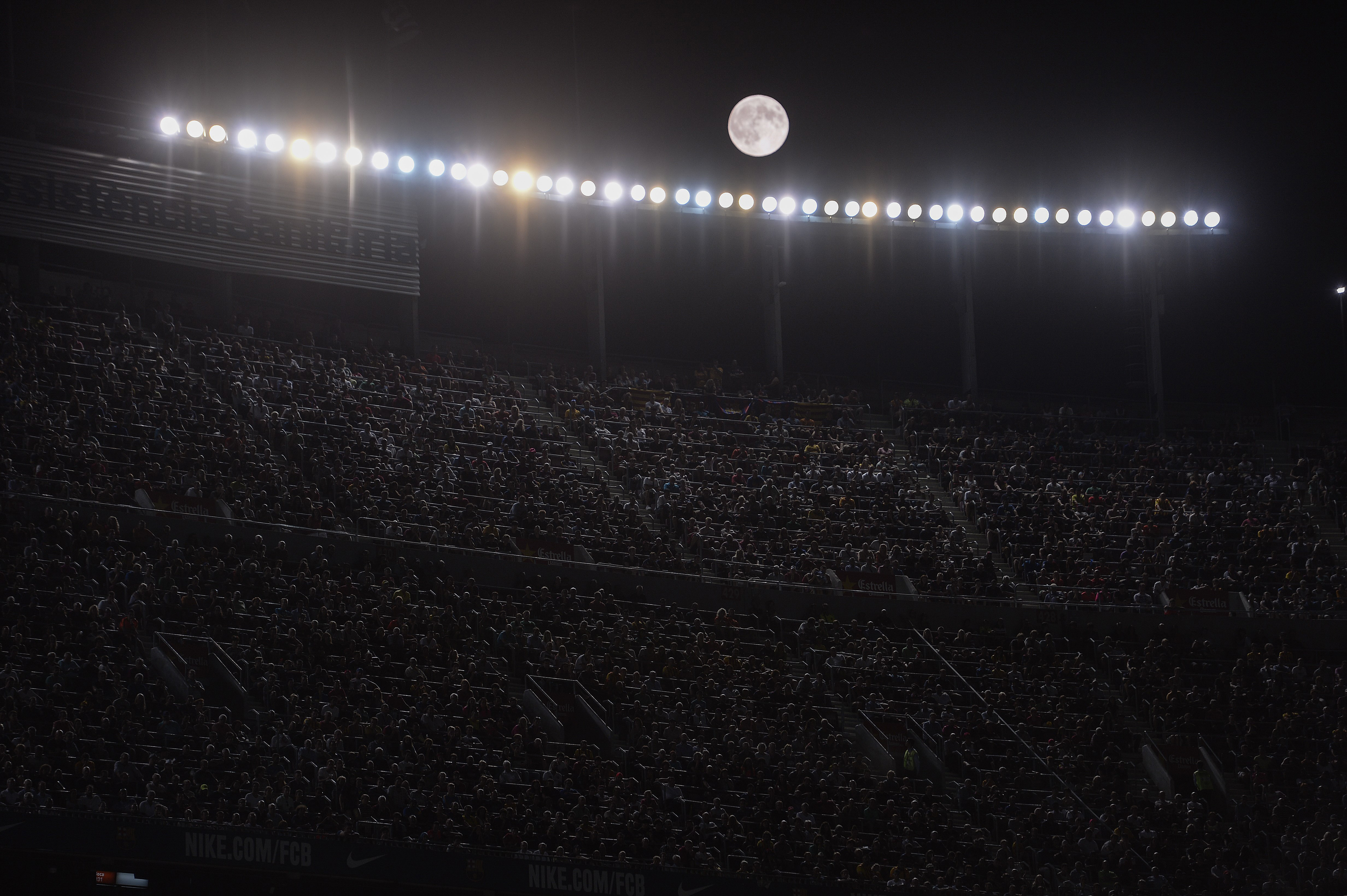 The moon shines during the Spanish league football match FC Barcelona vs Malaga CF at the Camp Nou stadium in Barcelona on Aug. 29, 2015.