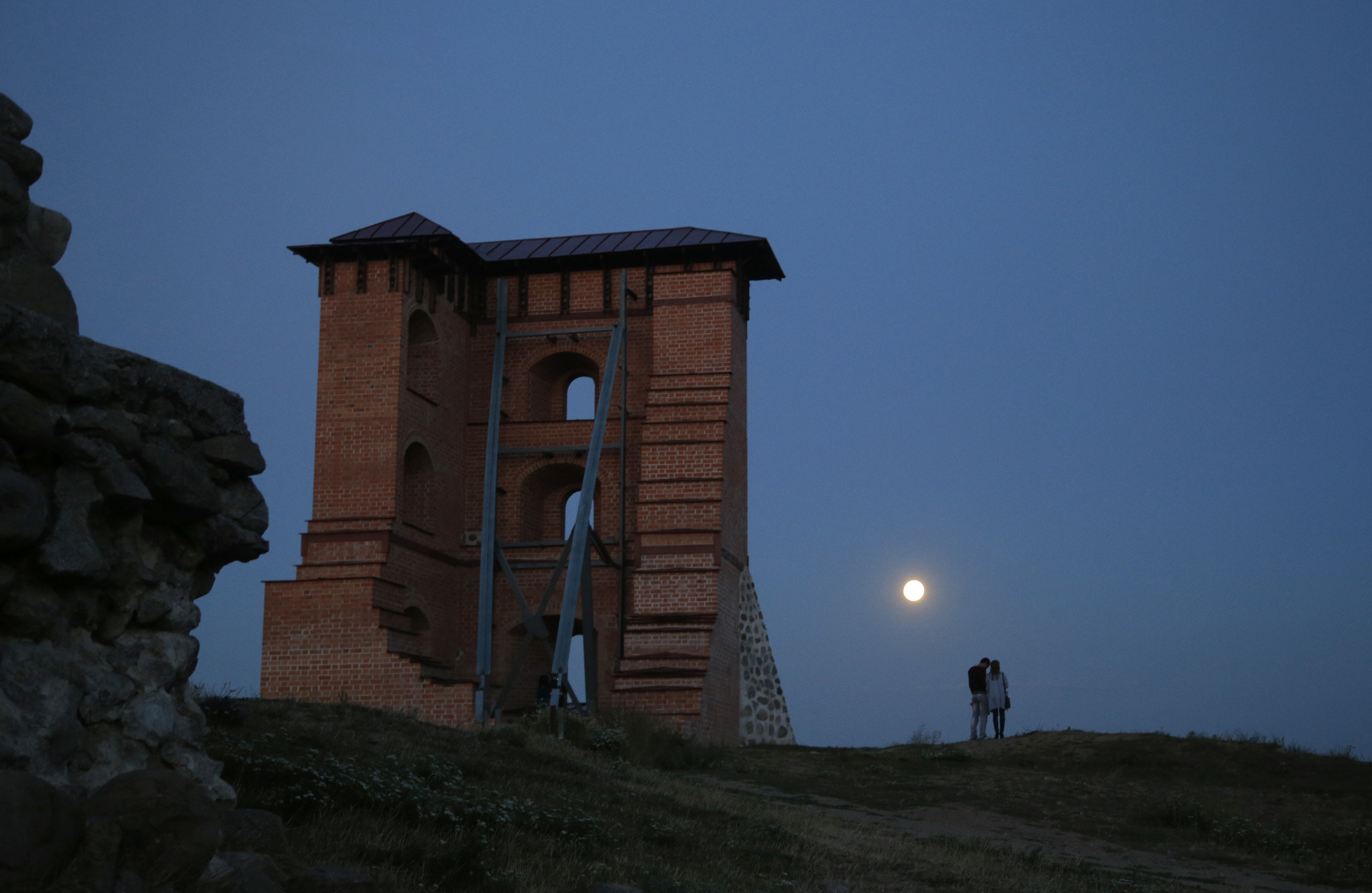 A perigee moon, also known as a super moon, rises above the remains of a medieval fortress in the town of Novogrudok, Belarus on Aug. 29, 2015.