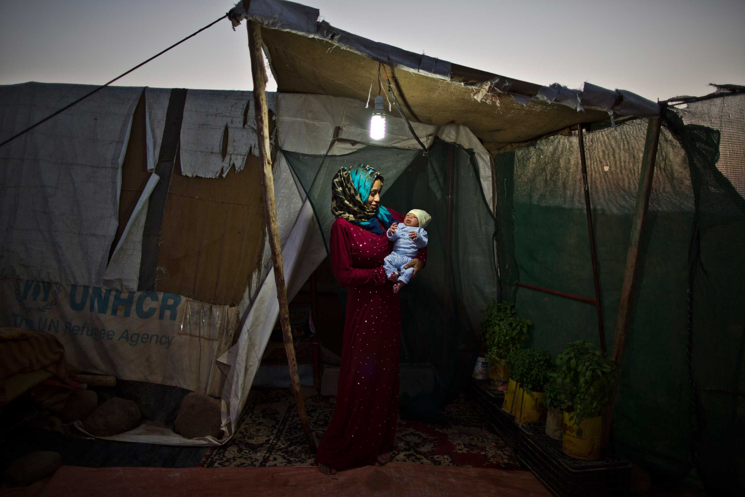 After delivering her first son safely despite fears of medical complications, Huda Alsayil says she now feels complete for the first time in months.  Holding him feels like the best gift I could be granted.  Huda Alsayil, 20, holds her week-old son Mezwid on Aug. 1, 2015.