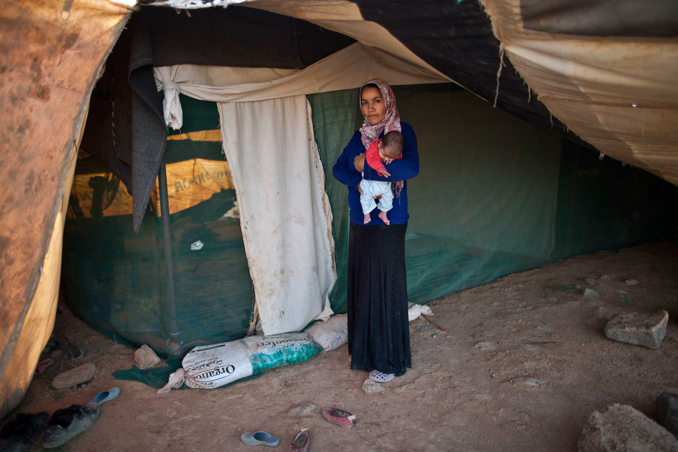 I delivered several days after my due day and I was so afraid. We had to borrow money for me to deliver and up to now my husband hasn't paid it back. He can't afford it.  Khalida Moussa, 28, holds her 5-week-old son Abdulelah, on Aug. 14, 2015.