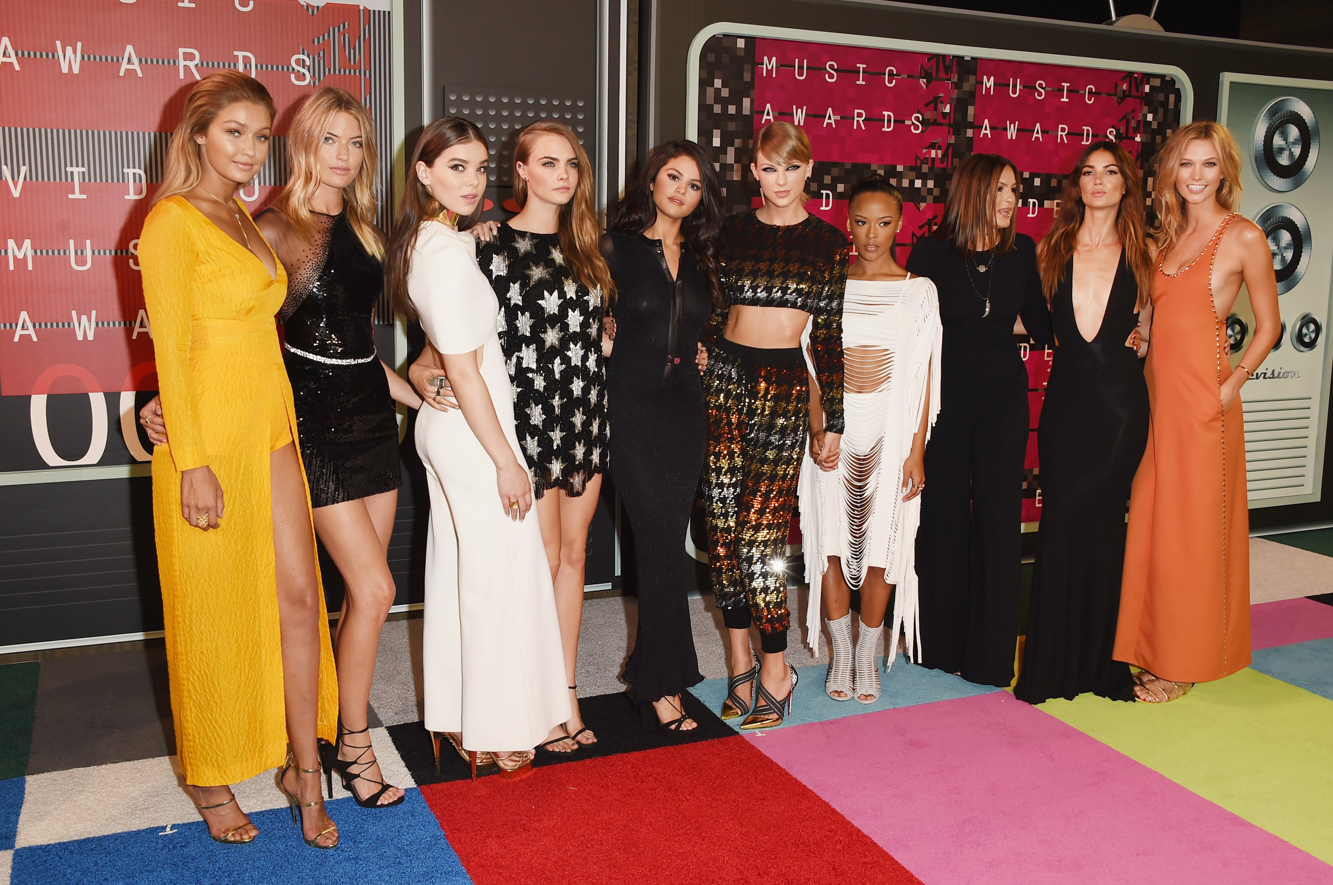 From left: Models Gigi Hadid, Martha Hunt, actress Hailee Steinfeld, model Cara Delevingne, Selena Gomez, Taylor Swift, model Serayah, Mariska Hargitay, models Lily Aldridge and Karlie Kloss attend the 2015 MTV Video Music Awards at Microsoft Theater on Aug. 30, 2015 in Los Angeles.