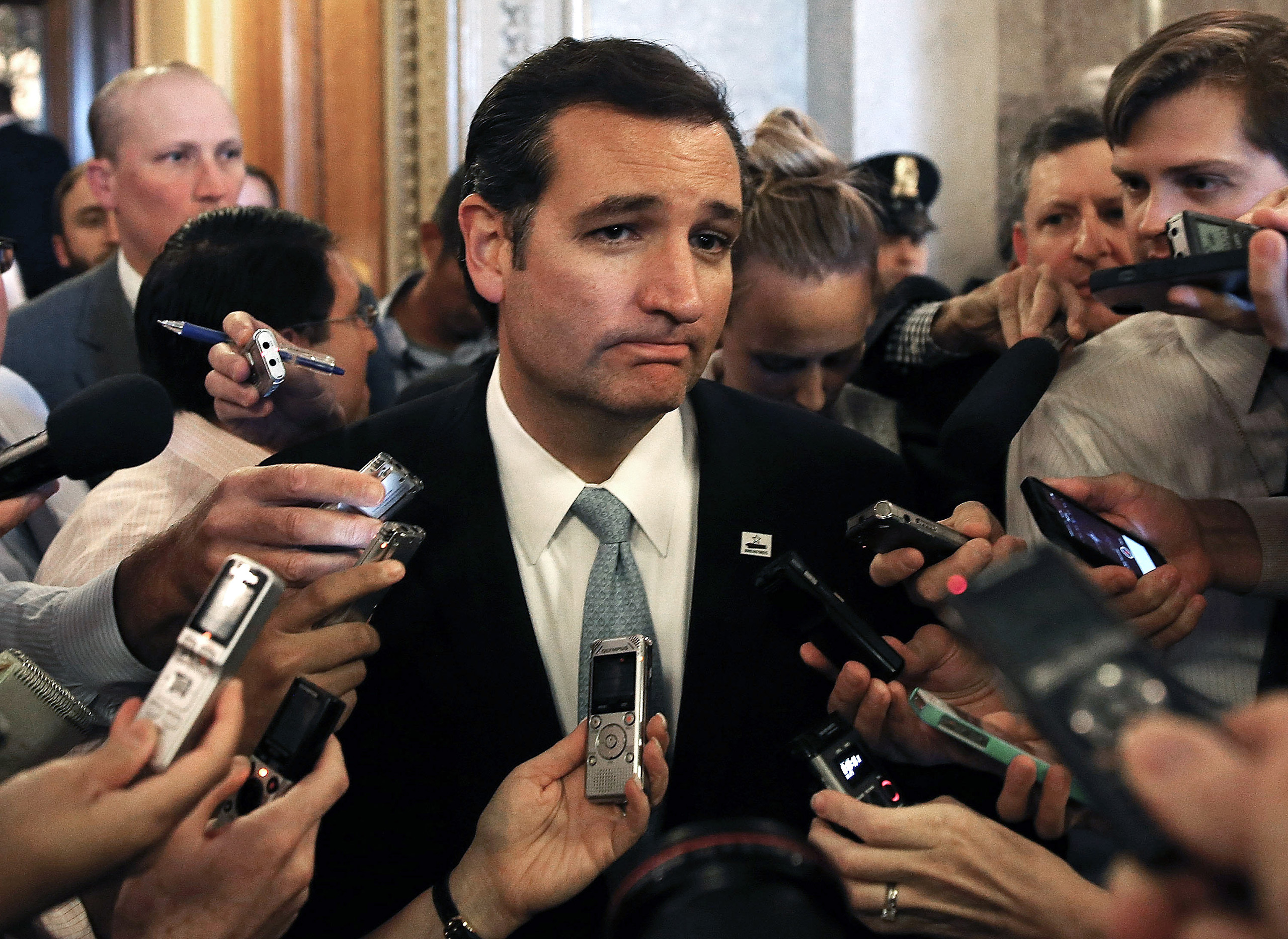 Sen. Ted Cruz speaks to reporters after his marathon speech on the Senate floor for more than 21 hours against Obamacare, preceding a government shutdown, on Capitol Hill in Washington on Sept. 25, 2013.