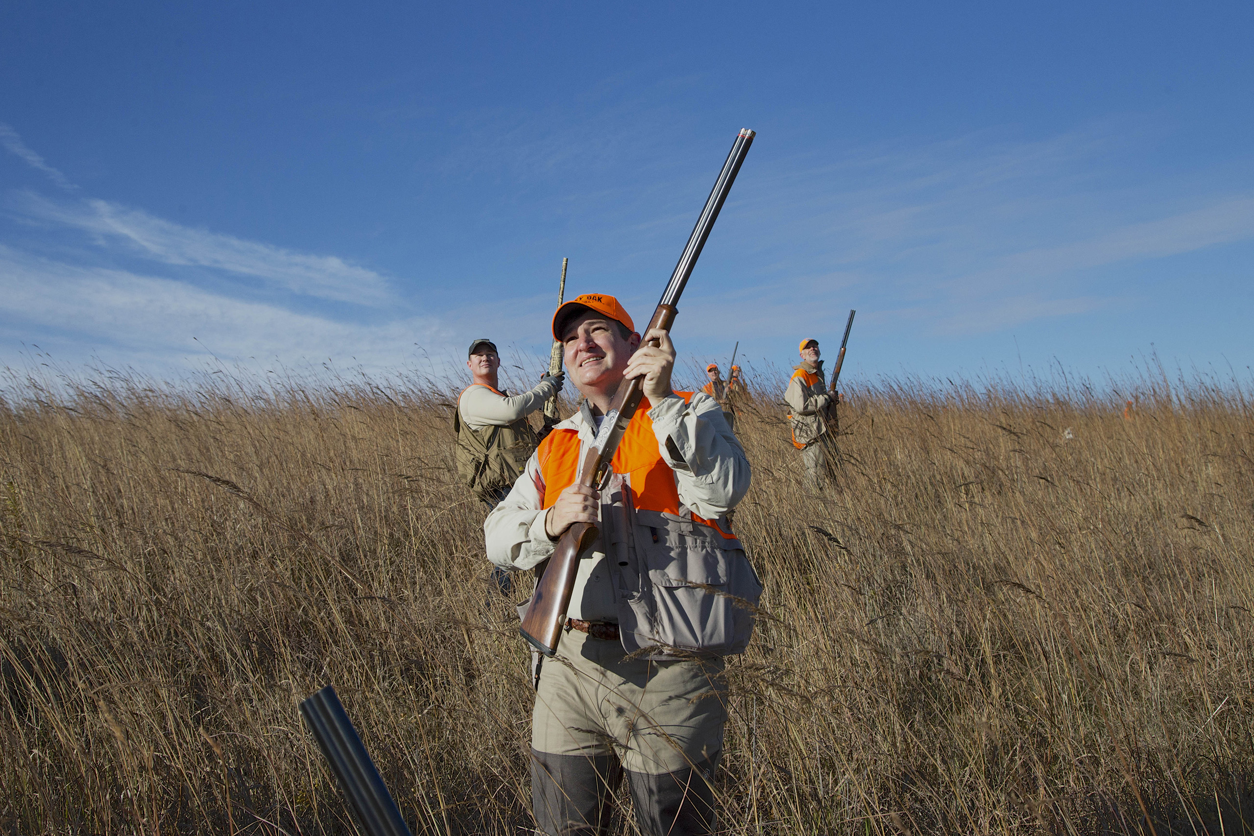 Sen. Ted Cruz follows through after shooting at a pheasant during a hunt in Akron, Iowa, Oct. 26, 2013.