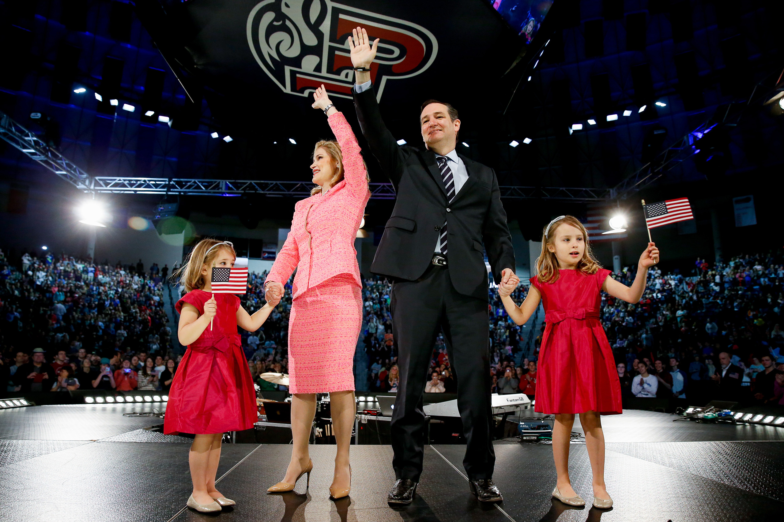 Ted Cruz, his wife Heidi, and their two daughters, Catherine and Caroline, wave on stage after he announced his campaign for president, the first candidate to officially enter the race, in Lynchburg, Va. on March. 23, 2015.