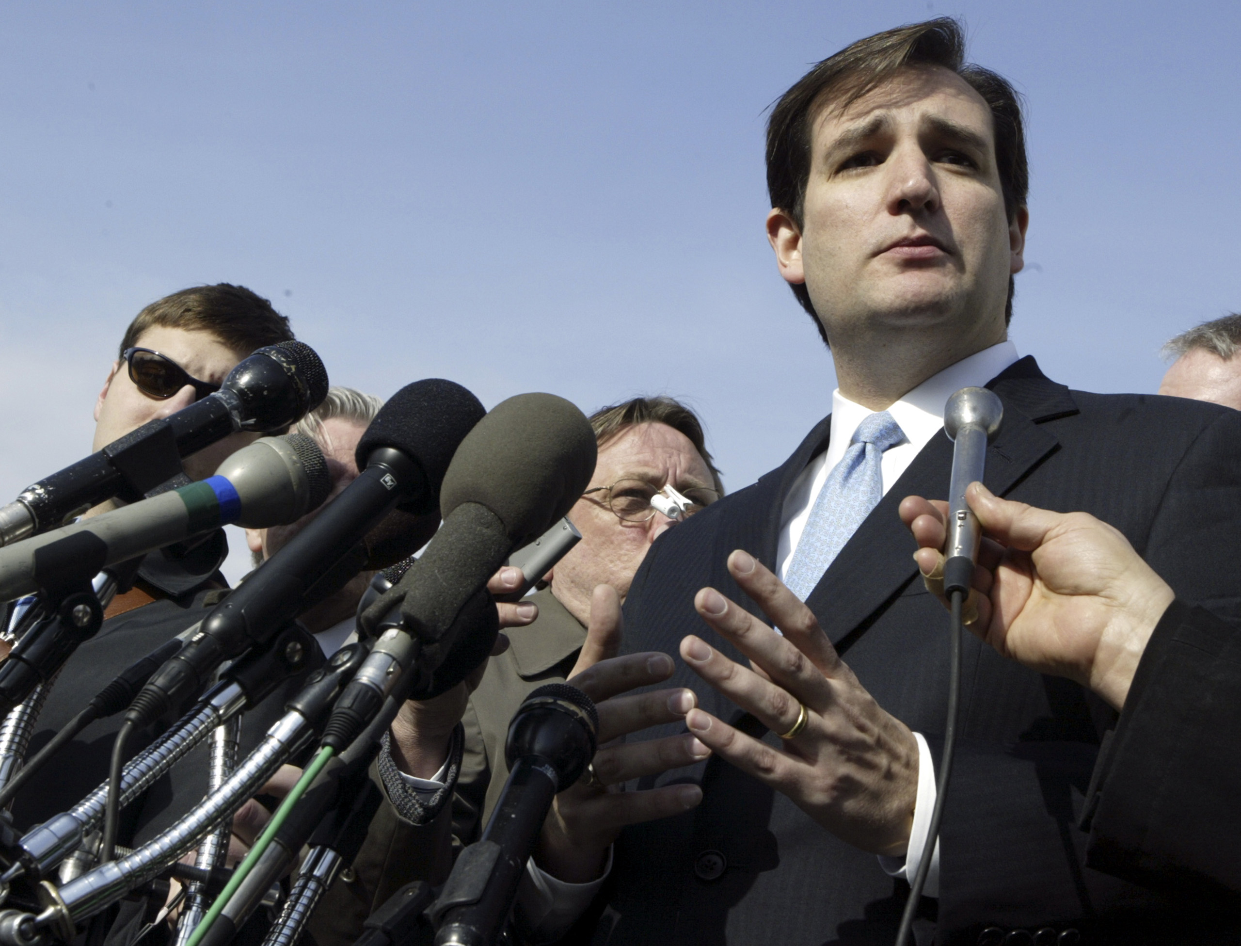 Ted Cruz, Solicitor General of Texas, addresses the press outside the Supreme Court after defending the redistricting of Texas, in Washington on March 1, 2006.