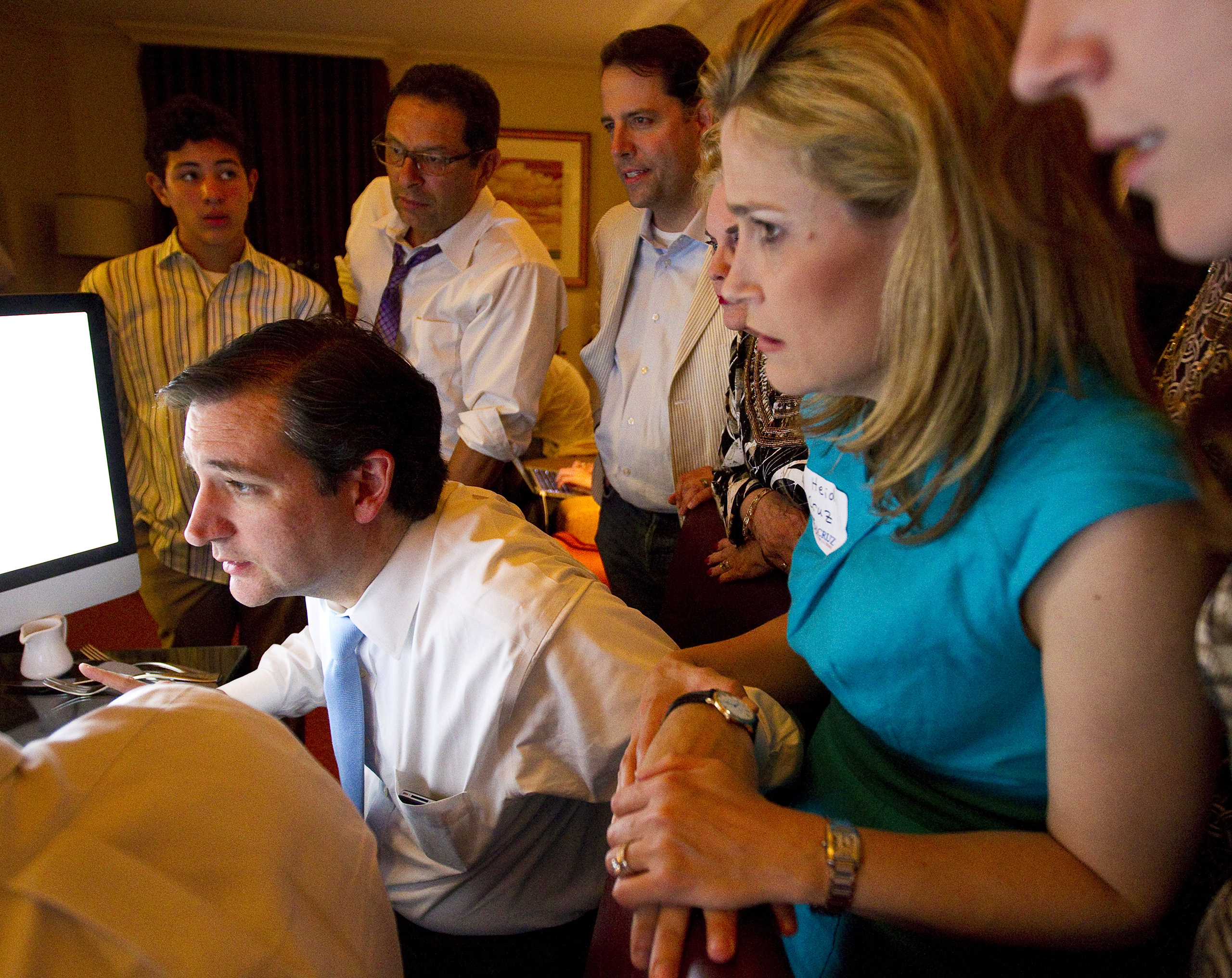 Ted Cruz, Republican candidate for U.S. Senate, holds hands with his wife Heidi Cruz as he watches polls with his campaign team, friends and family, May 29, 2012.