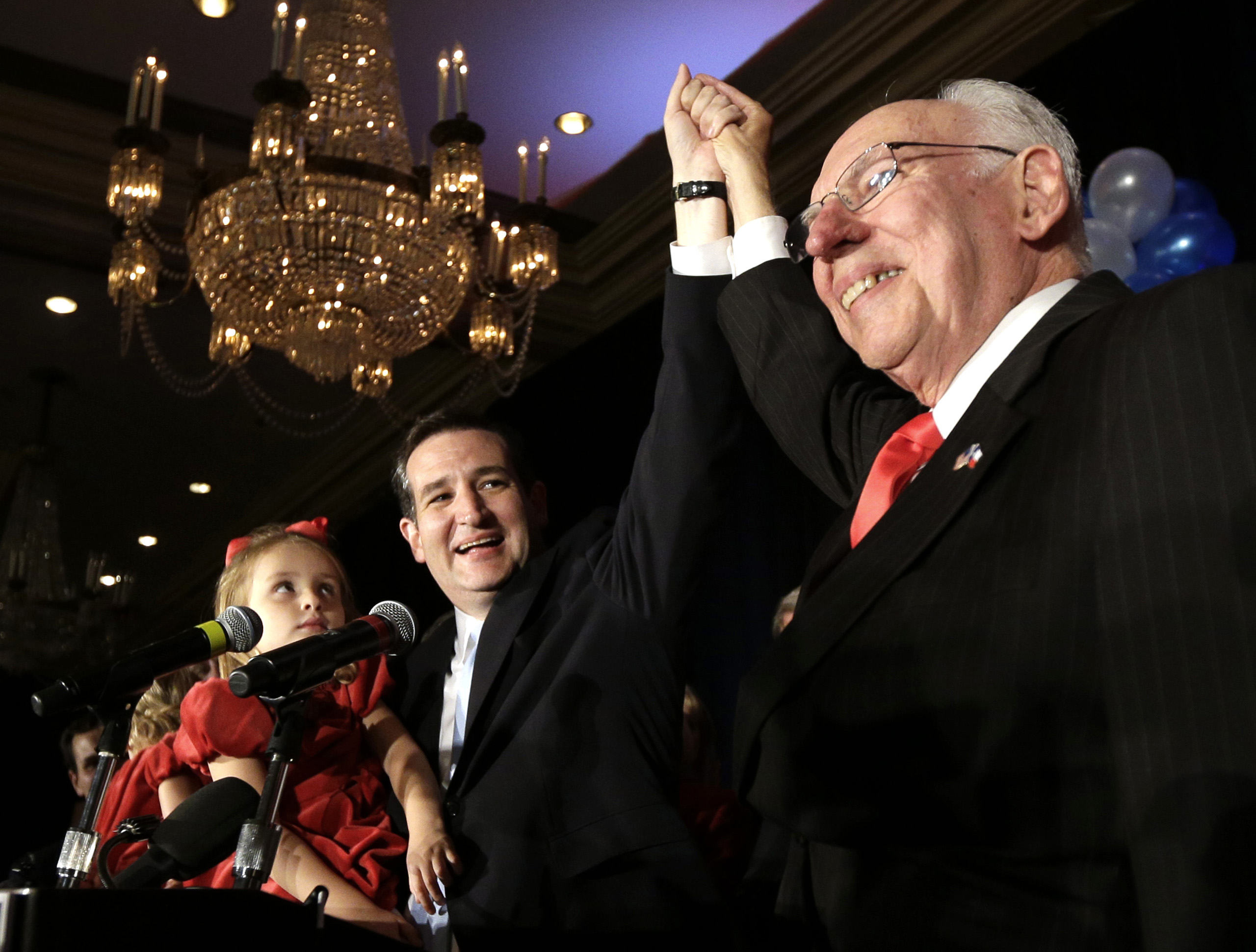 Republican candidate for U.S. Senate Ted Cruz, left, raises his hand with his father Rafael, right, while holding his daughter Caroline during a victory speech after being elected in Houston on Nov. 6, 2012.
