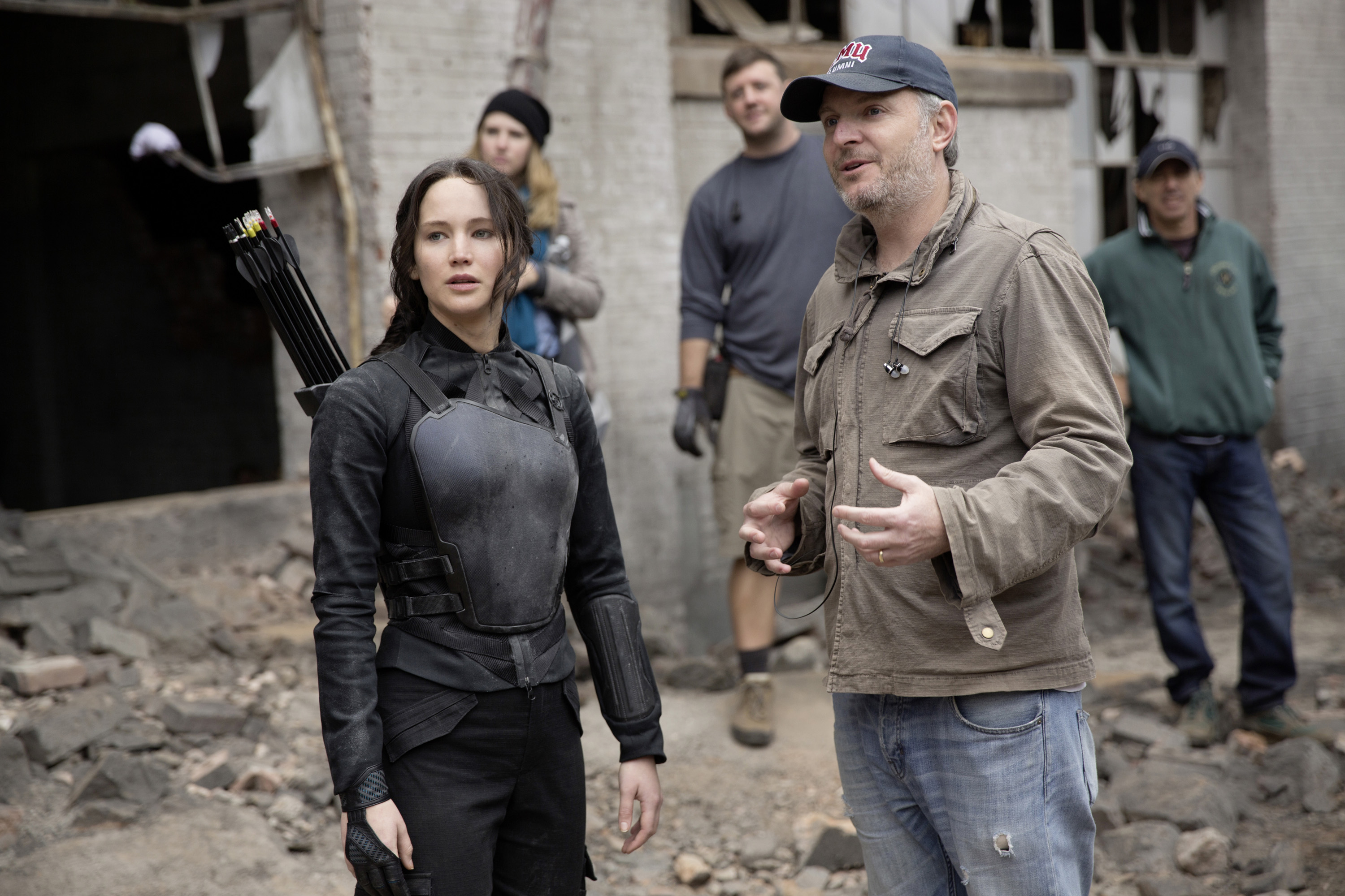 Jennifer Lawrence working with director Francis Lawrence on the set of <i> The Hunger Games: Mockingjay - Part 1</i>.