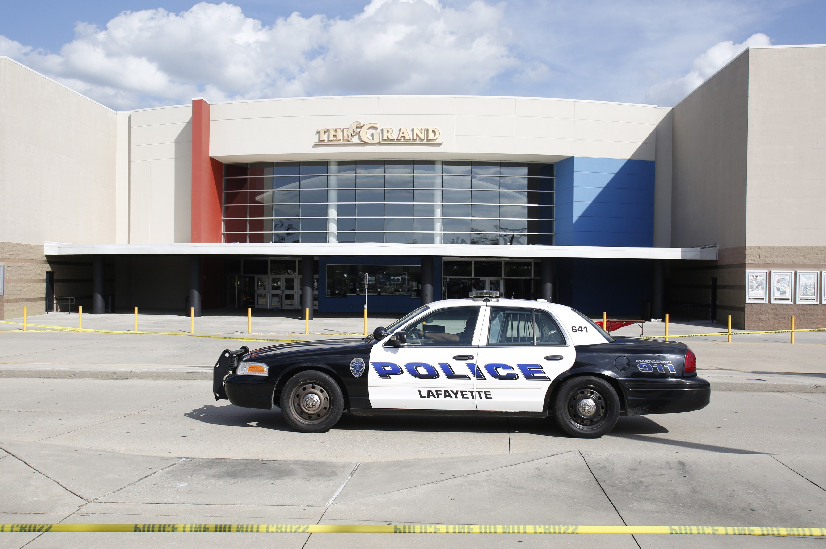A police car stands outside The Grand Theatre on July 24, 2015 in Lafayette, La., following the previous night's deadly shooting.