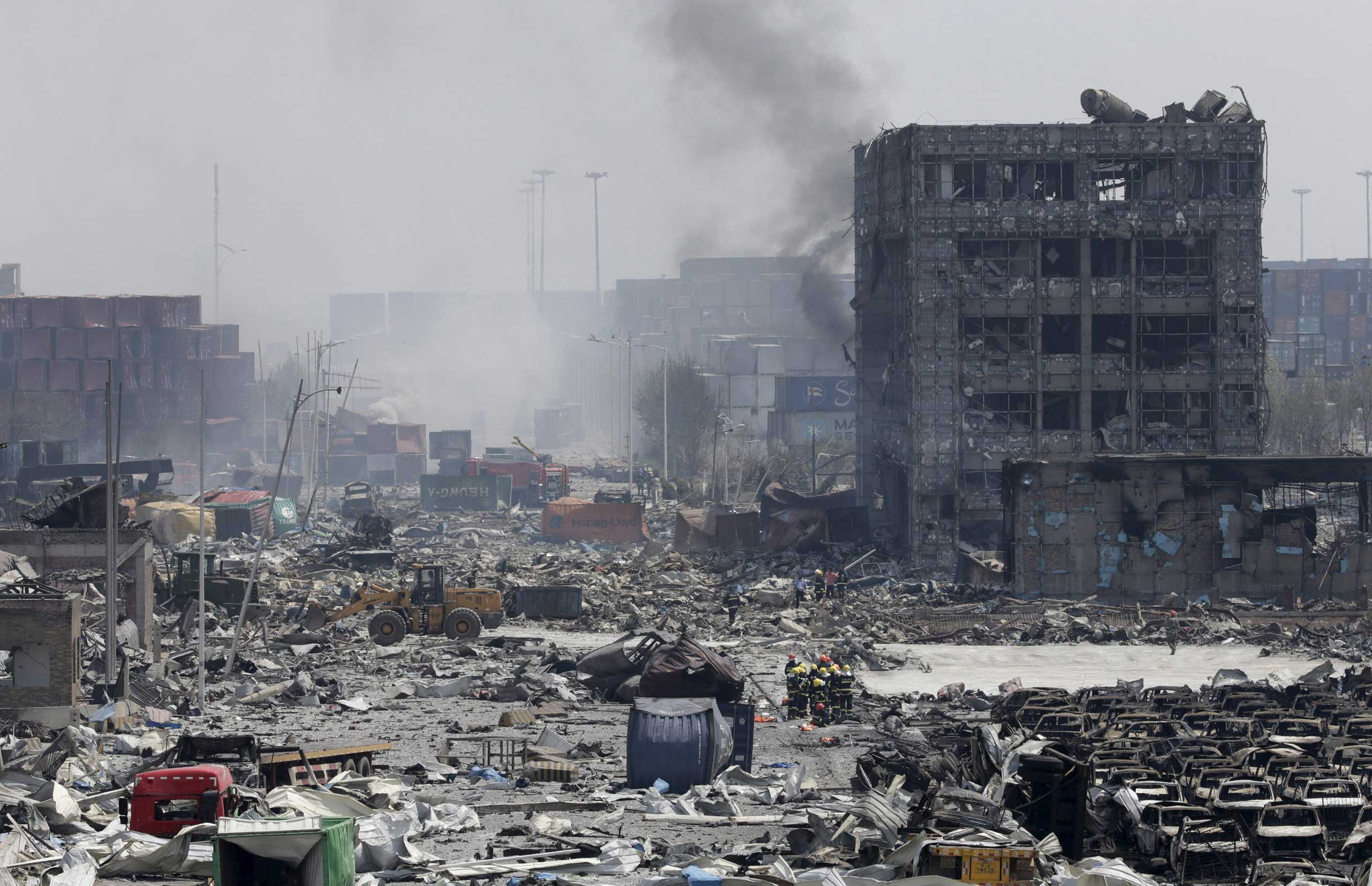 Smoke rises from the site of the explosions at the Binhai new district, Tianjin, on Aug. 13, 2015.