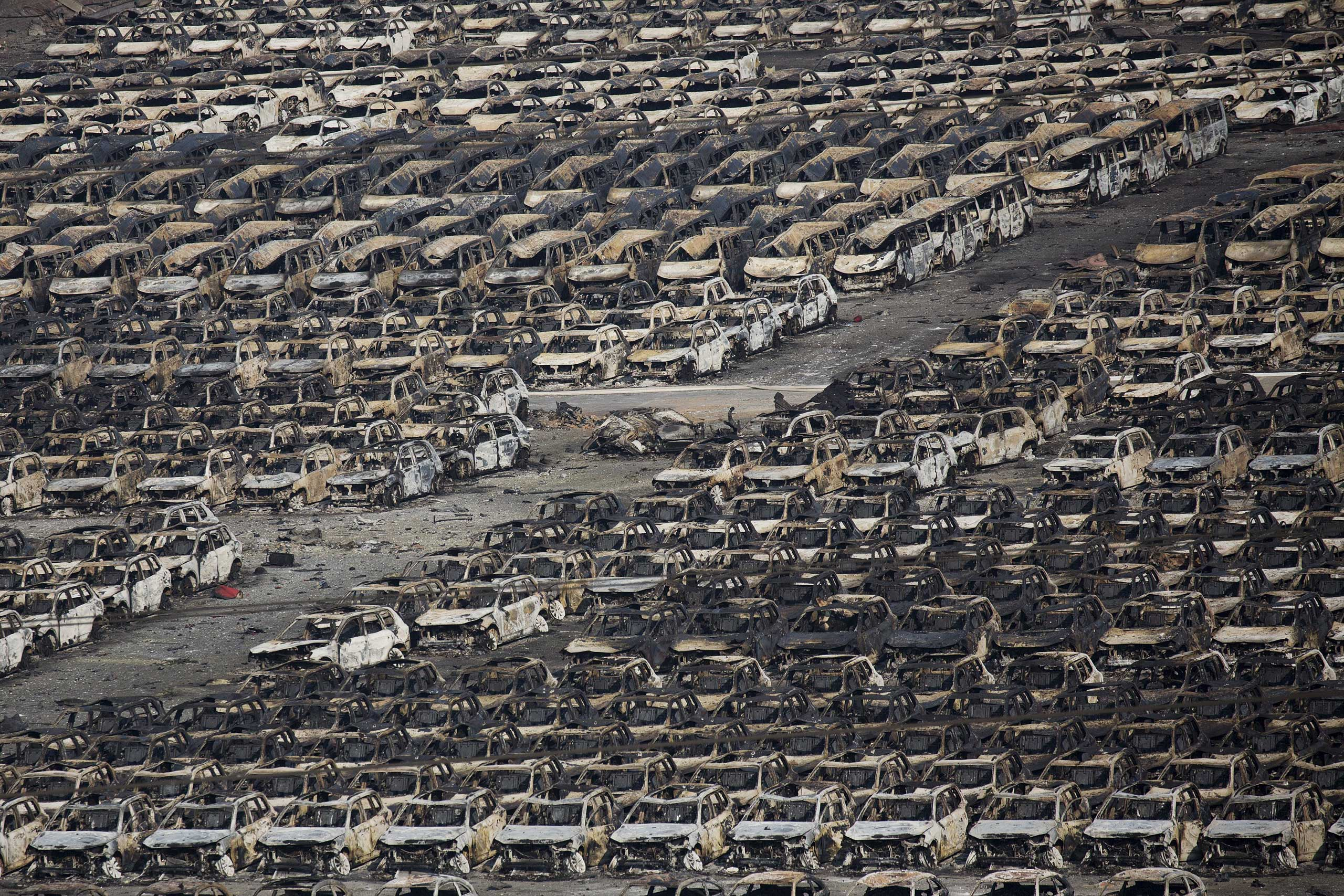 Burnt cars are seen near the site of the explosions at the Binhai new district, Tianjin, on Aug. 13, 2015.