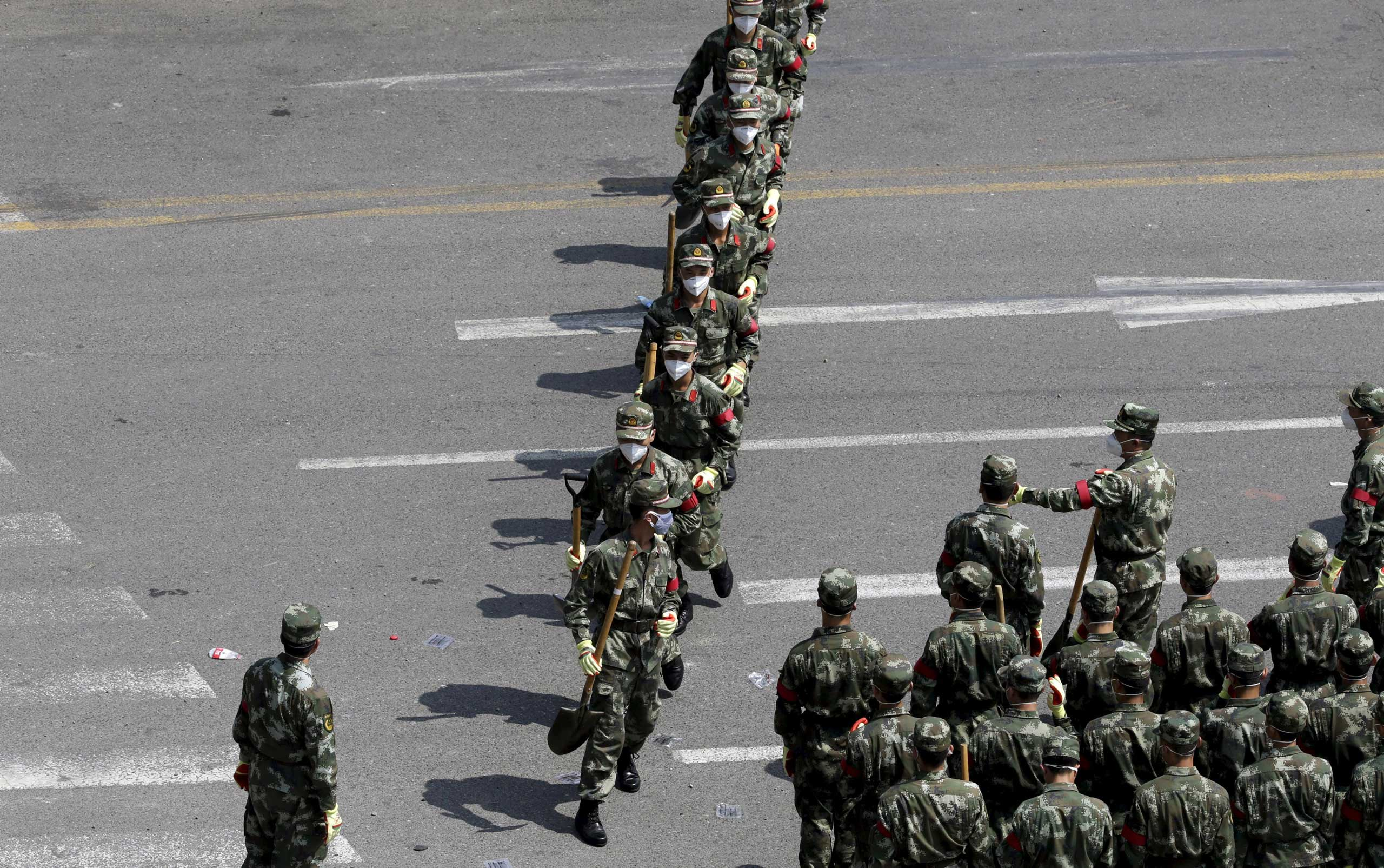 Paramilitary police prepare to enter the site of the explosions at the Binhai new district, Tianjin, on Aug. 13, 2015.