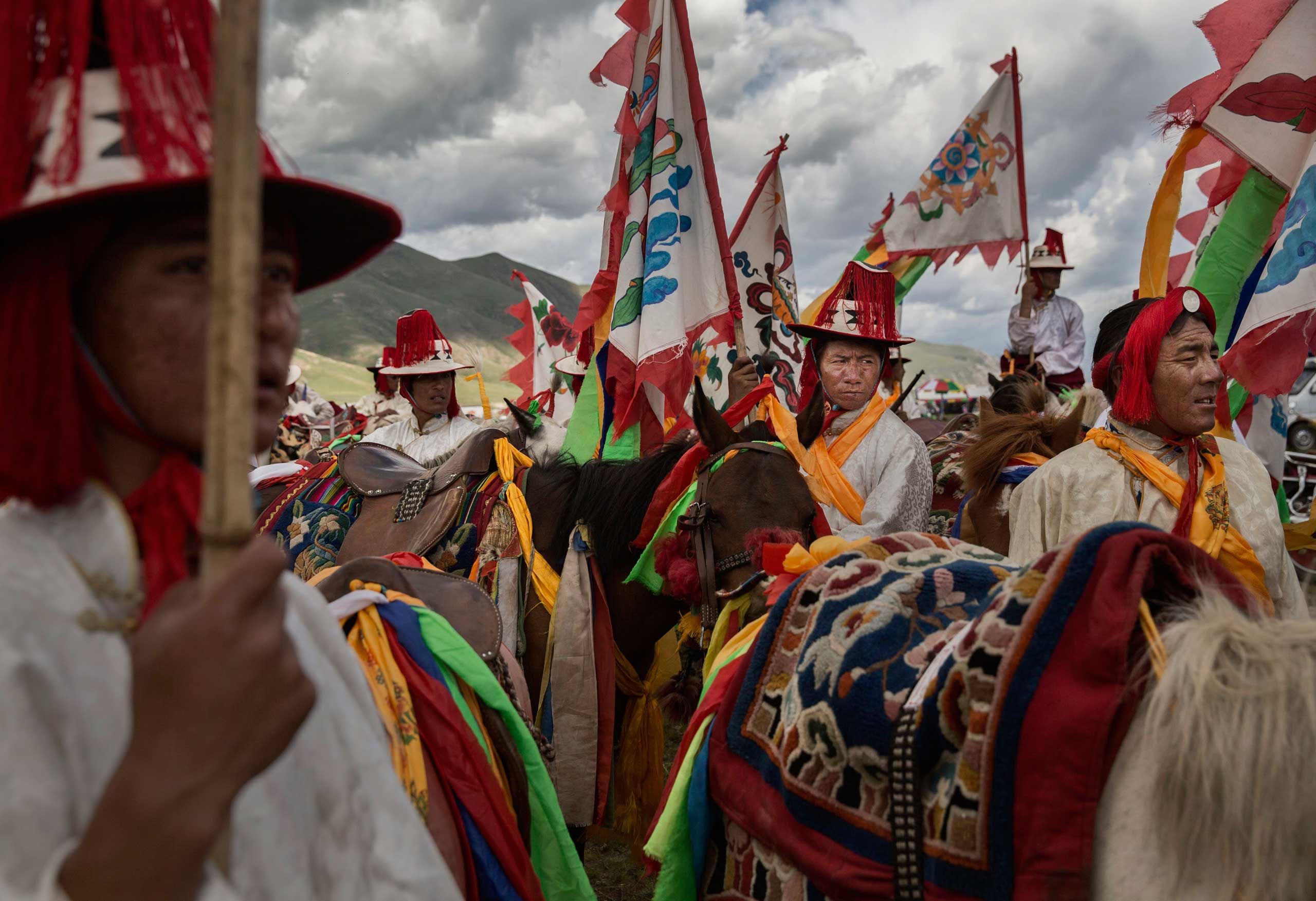 Ethnic Tibetan nomads wait to perform skills during a riding competition at a local festival on the Tibetan Plateau in Yushu County, on July 26, 2015.