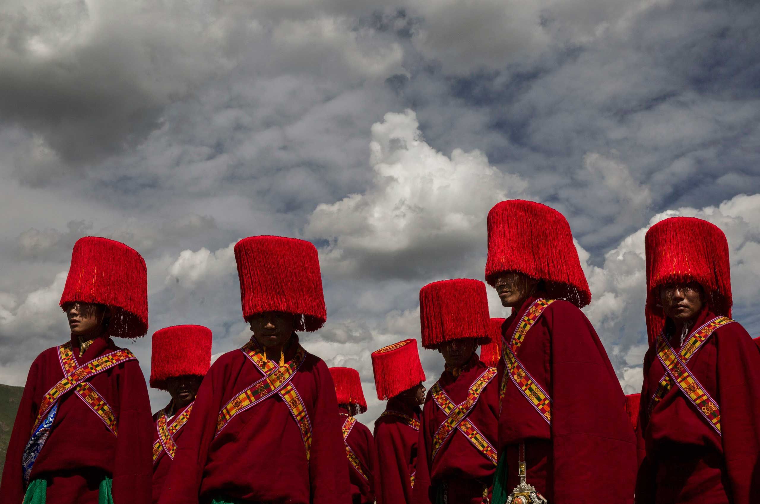Ethnic Tibetans in traditional dress wait to perform at a local government sponsored festival on the Tibetan Plateau in Yushu County, Qinghai, China, on on July 25, 2015.