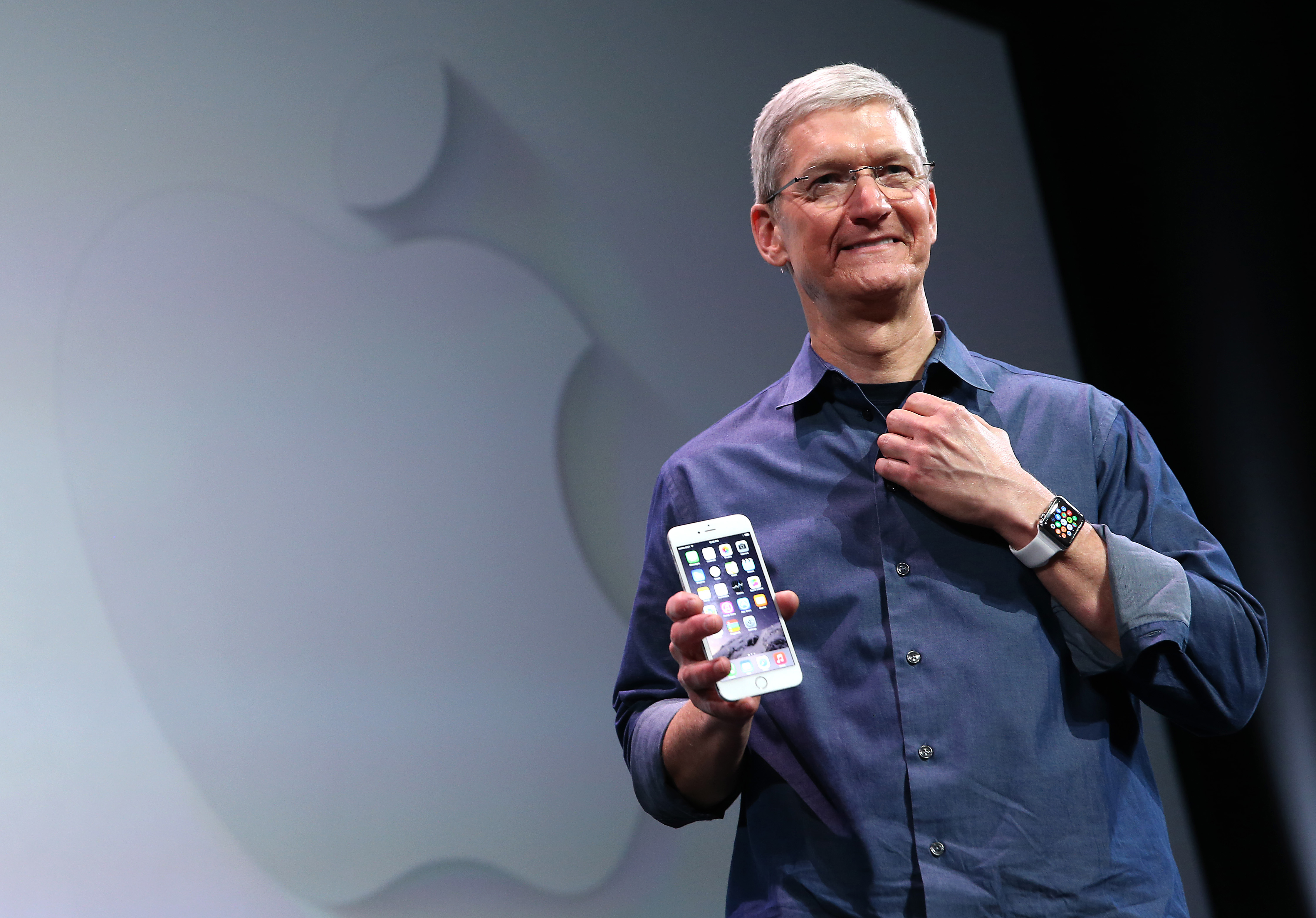 Apple CEO Tim Cook shows off the new iPhone 6 and the Apple Watch during an Apple special event at the Flint Center for the Performing Arts on September 9, 2014 in Cupertino, Calif.