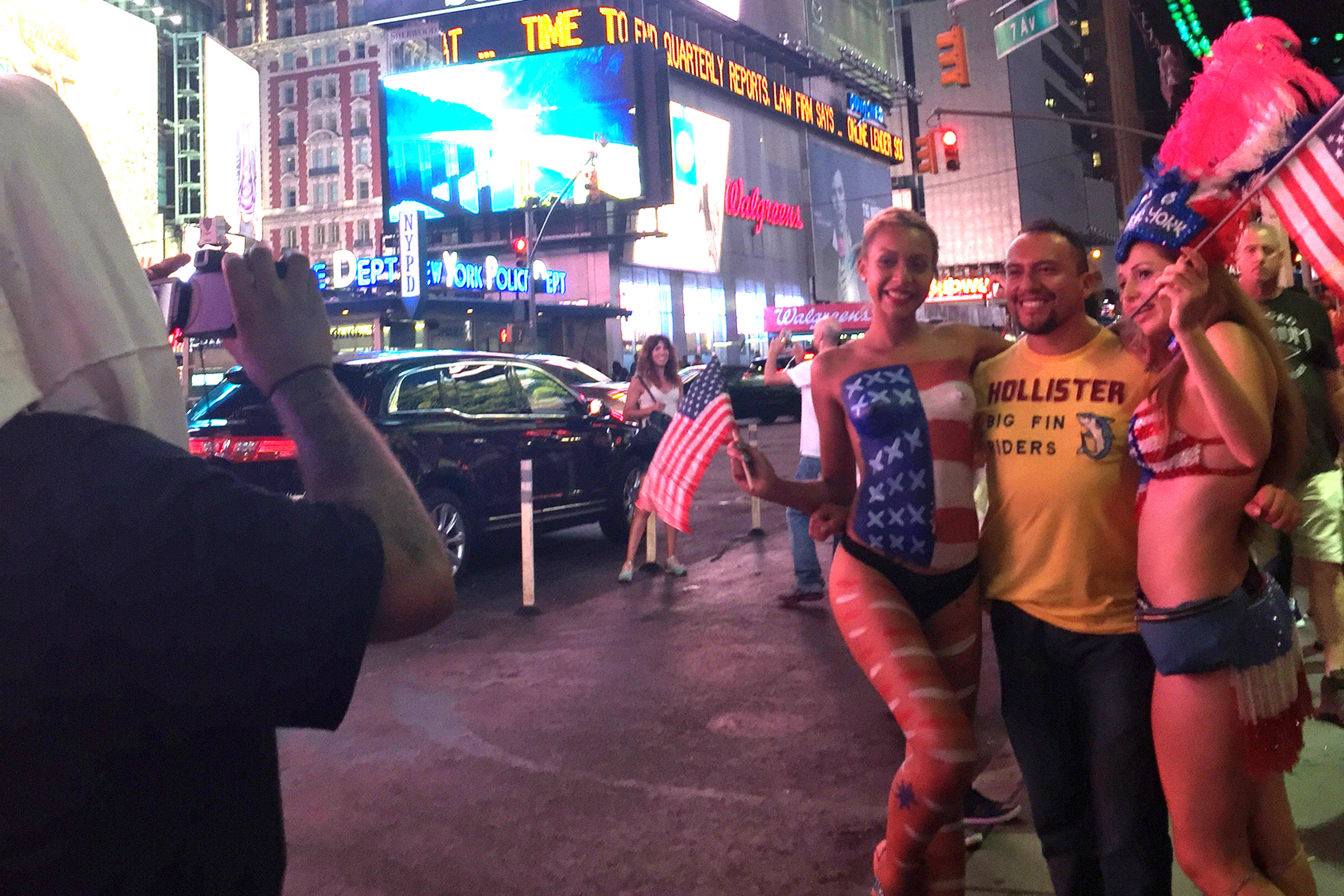 Lucky, center, poses in Times Square in New York City on Aug. 19, 2015.