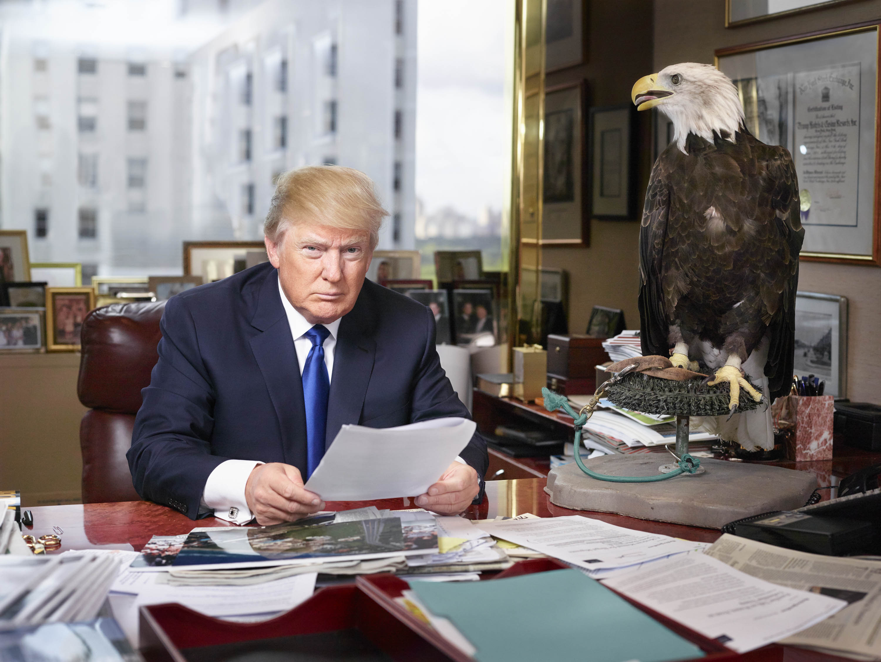 The Republican front runner in his corner office on the 25th floor of Trump Tower in New York City, photographed with a bald eagle named Uncle Sam.