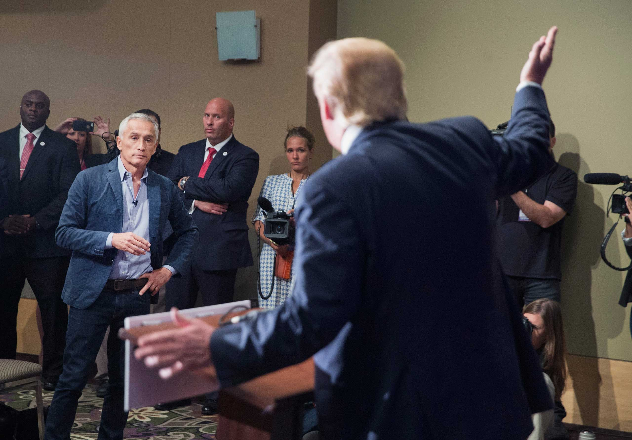 Republican presidential candidate Donald Trump fields a question from Univision and Fusion anchor Jorge Ramos during a press conference held before his campaign event at the Grand River Center in Dubuque, Iowa, on Aug. 25, 2015.