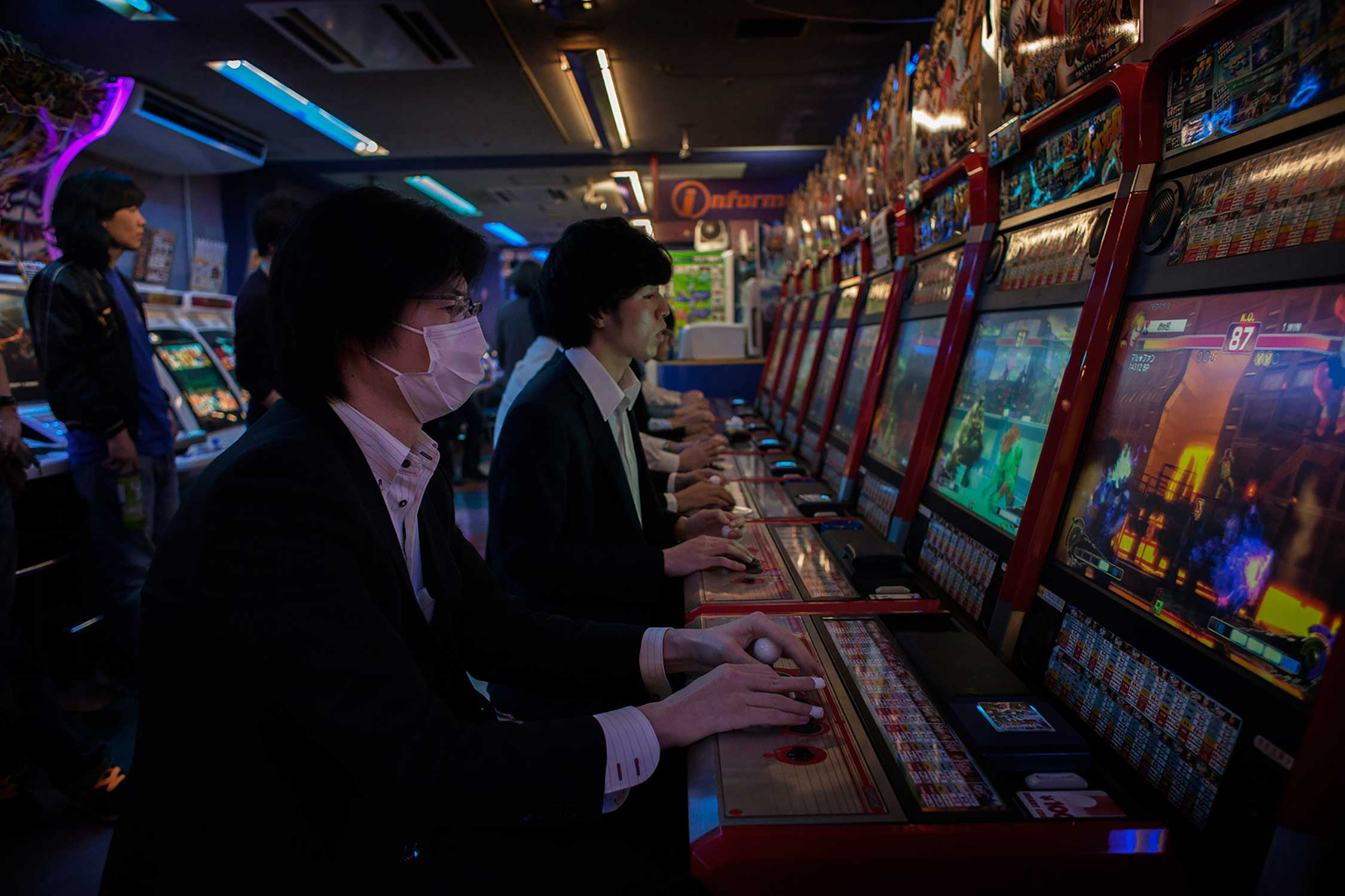 Men in suits play games in a Patchinko hall after work on a Friday night in Akihabara district, famous for its many playing halls and vivid Otome culture in Tokyo.