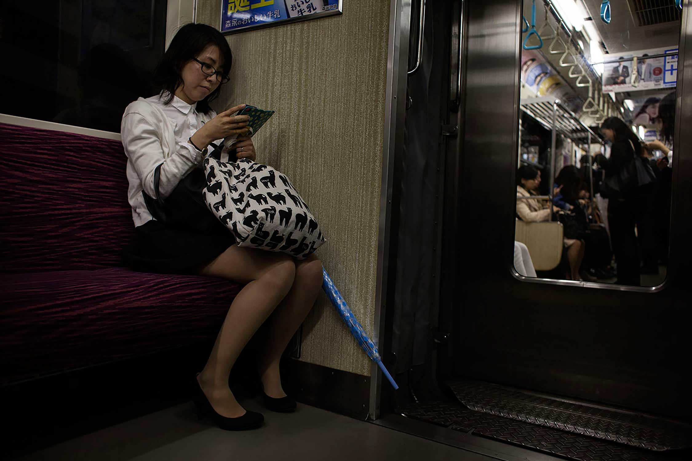 Hitomi often plays her romance simulation game while commuting to work with the Tokyo JR train line.