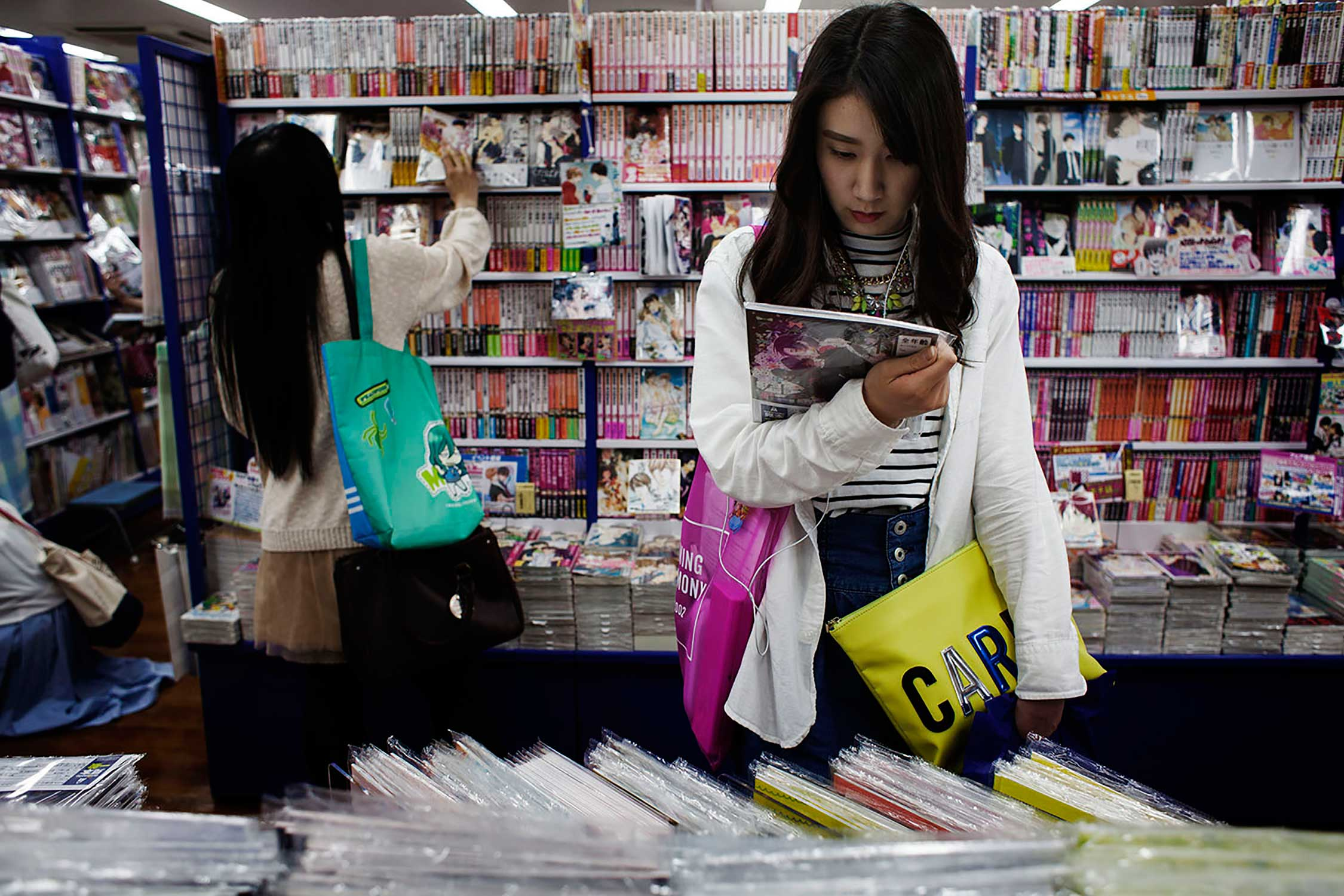 A girl shops for Boys Love Manga books in an Anime shop in downtown Tokyo.