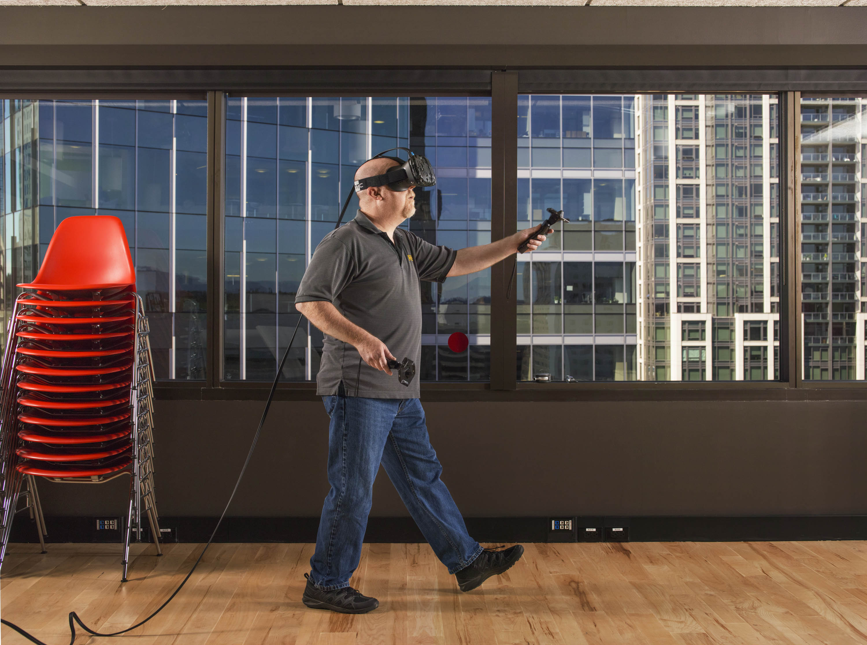 Ken Birdwell, a Valve engineer, demonstrates the Vive virtual-reality headset, which can track a user's locomotion, head movements and hand gestures.