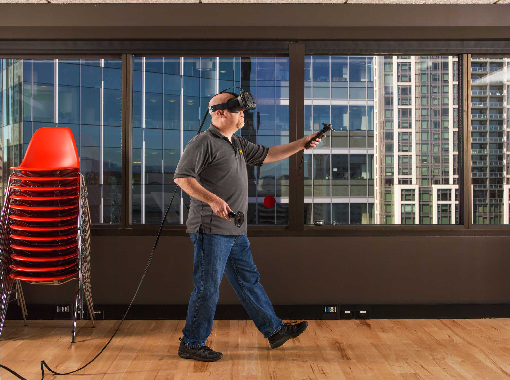 Ken Birdwell, an engineer from Valve, demonstrates the Vive virtual reality headset at the Valve headquarters in Seattle, Wash. on June 25, 2015.