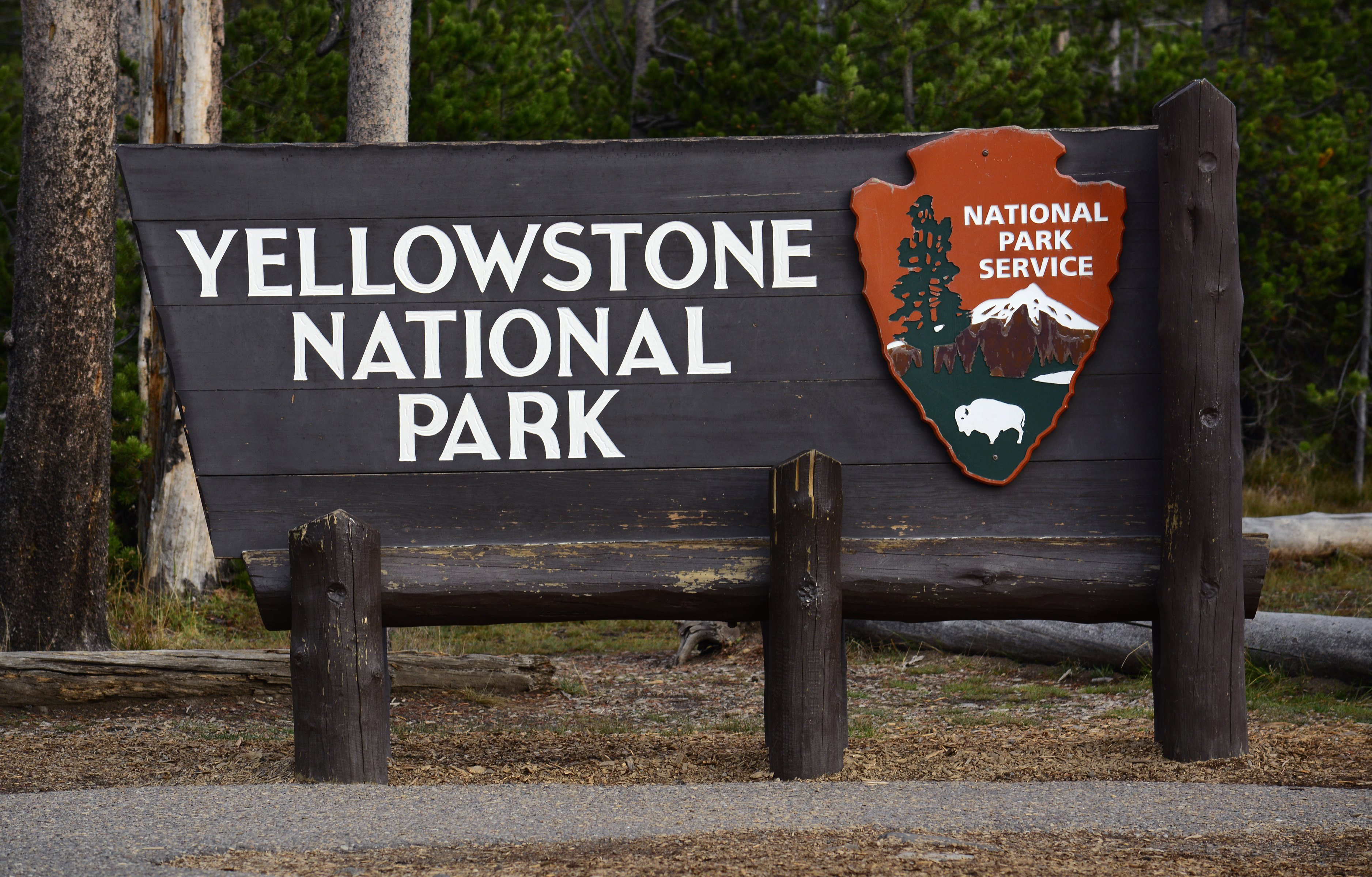 A National Park Service sign welcomes visitors to Yellowstone National Park in Wyoming.