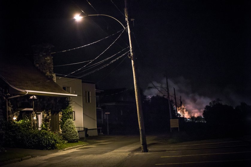 """Twenty-one hours after the derailment, July 6, 2013. From """"Post MÈgantic"""" by Michel Huneault, winner of the 2015 Lange-Taylor Prize."""