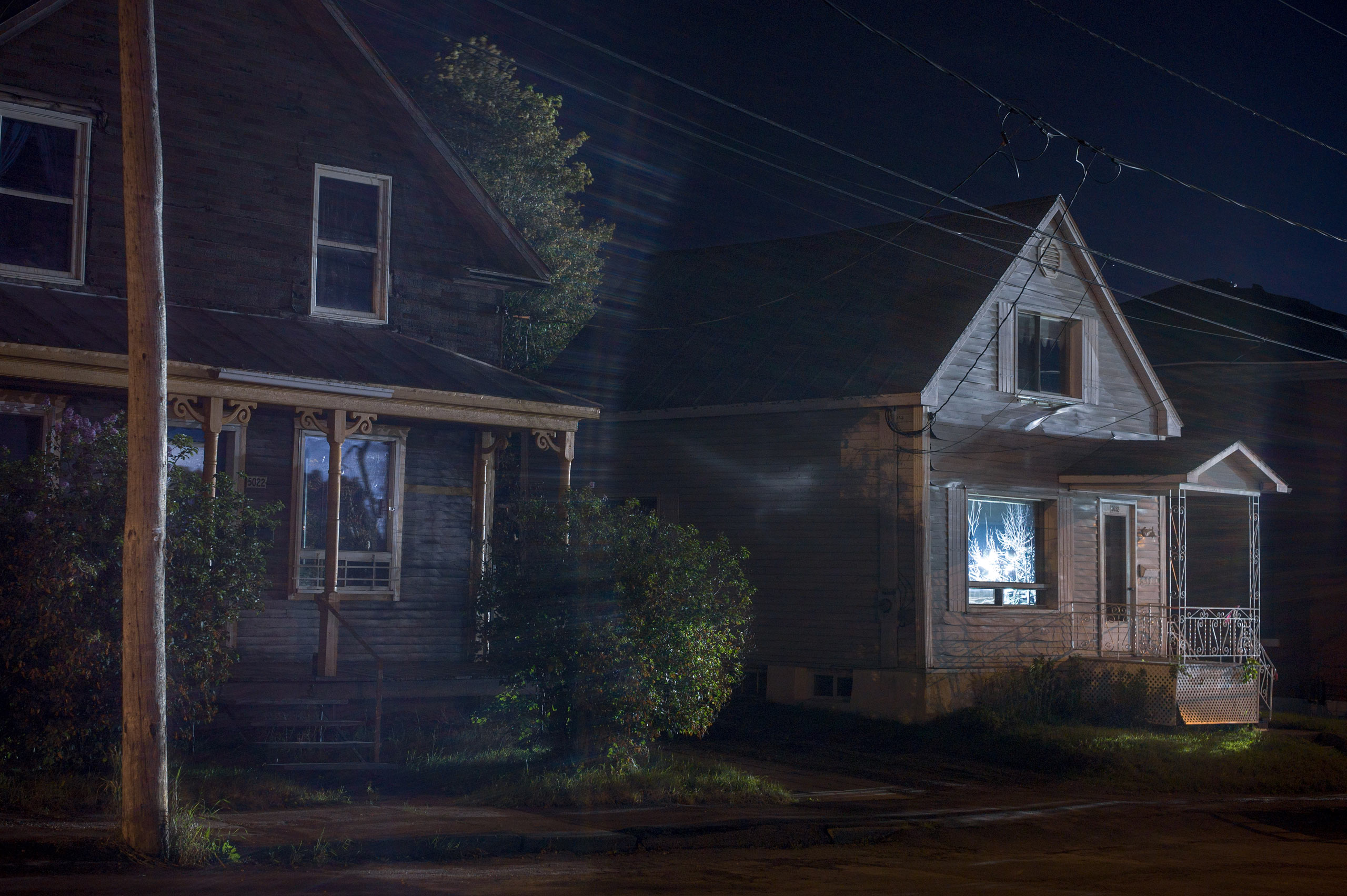 Houses lit by spotlights from the Red Zone, Aug. 2013. From the series  Post Mégantic.