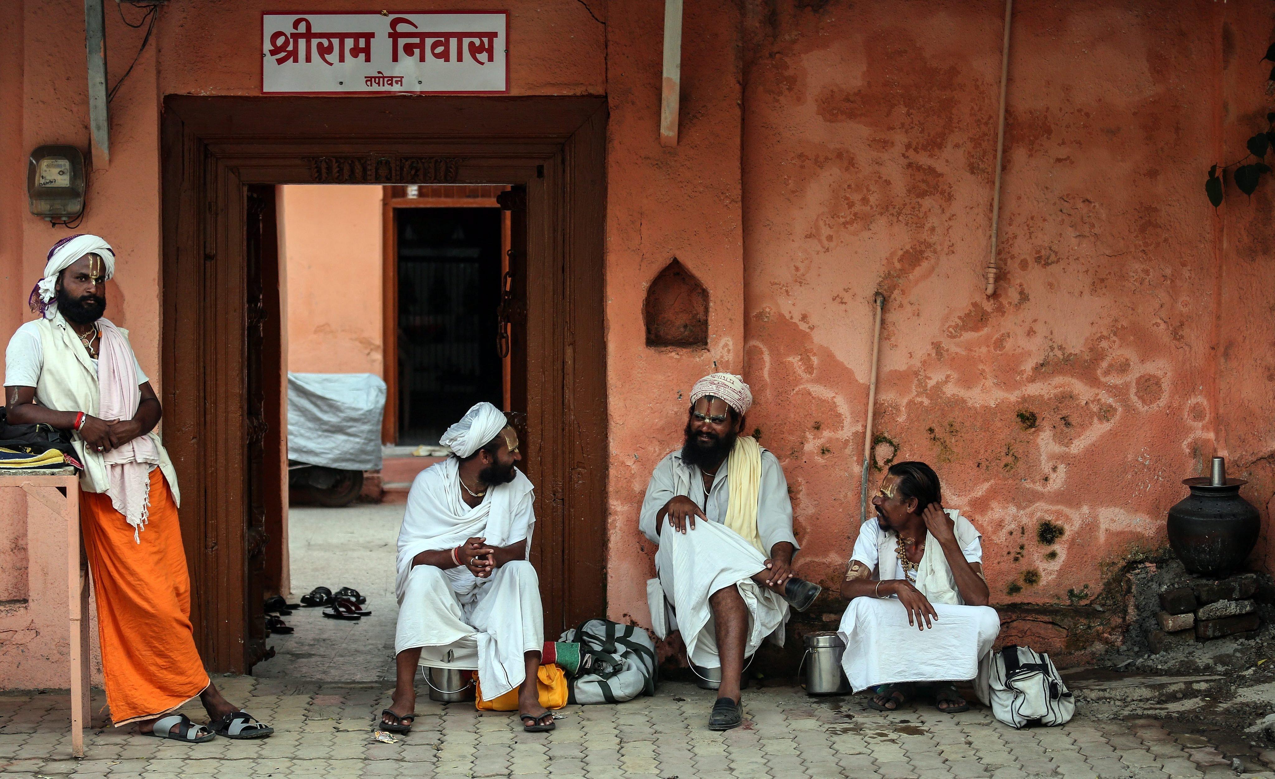 Indian sadhu or holy men sit near the banks of Godavari river during the Kumbh Mela festival in Nasik, India, on Aug. 28, 2015.
