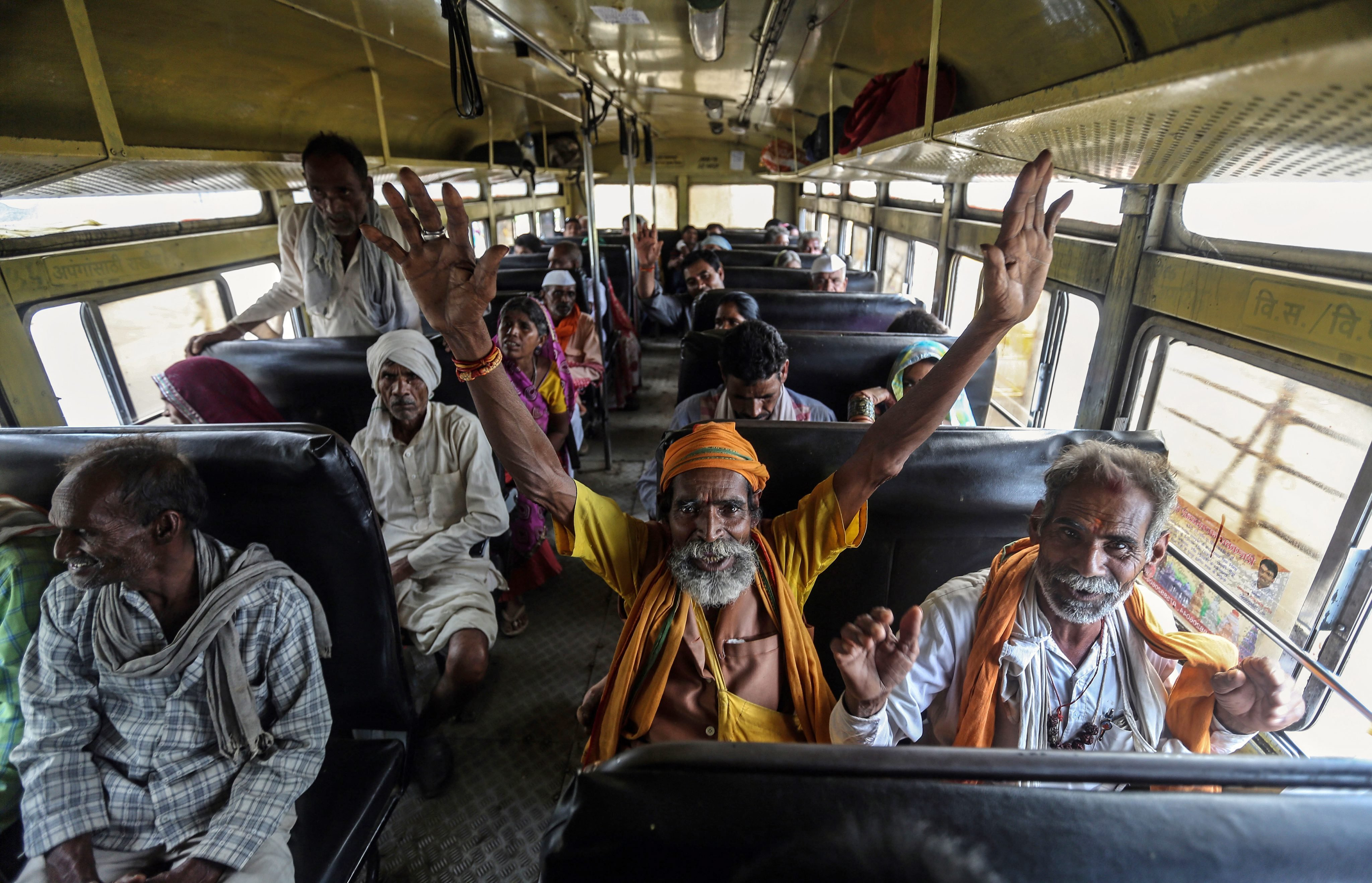 Indian sadhu or holy men shout religious slogans in the bus as they leave from Trimbakeshwar Temple during the Kumbh Mela festival in Nasik, India, on Aug. 28, 2015.