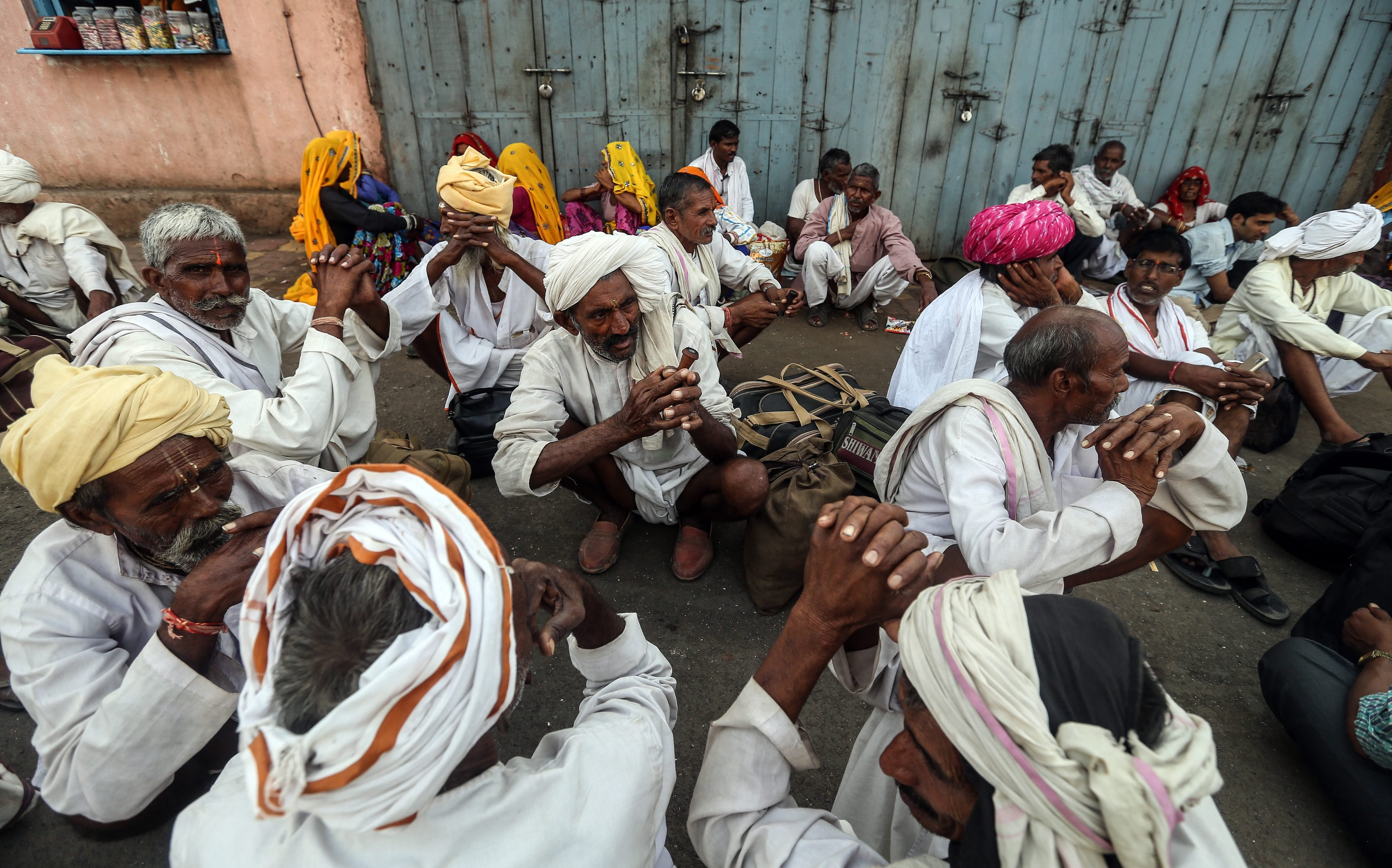 Indian devotees sit after the first Shahi Snan (Royal bathing) on the banks of Godavari river at the Kumbh Mela festival in Nasik, India, on Aug. 29, 2015.