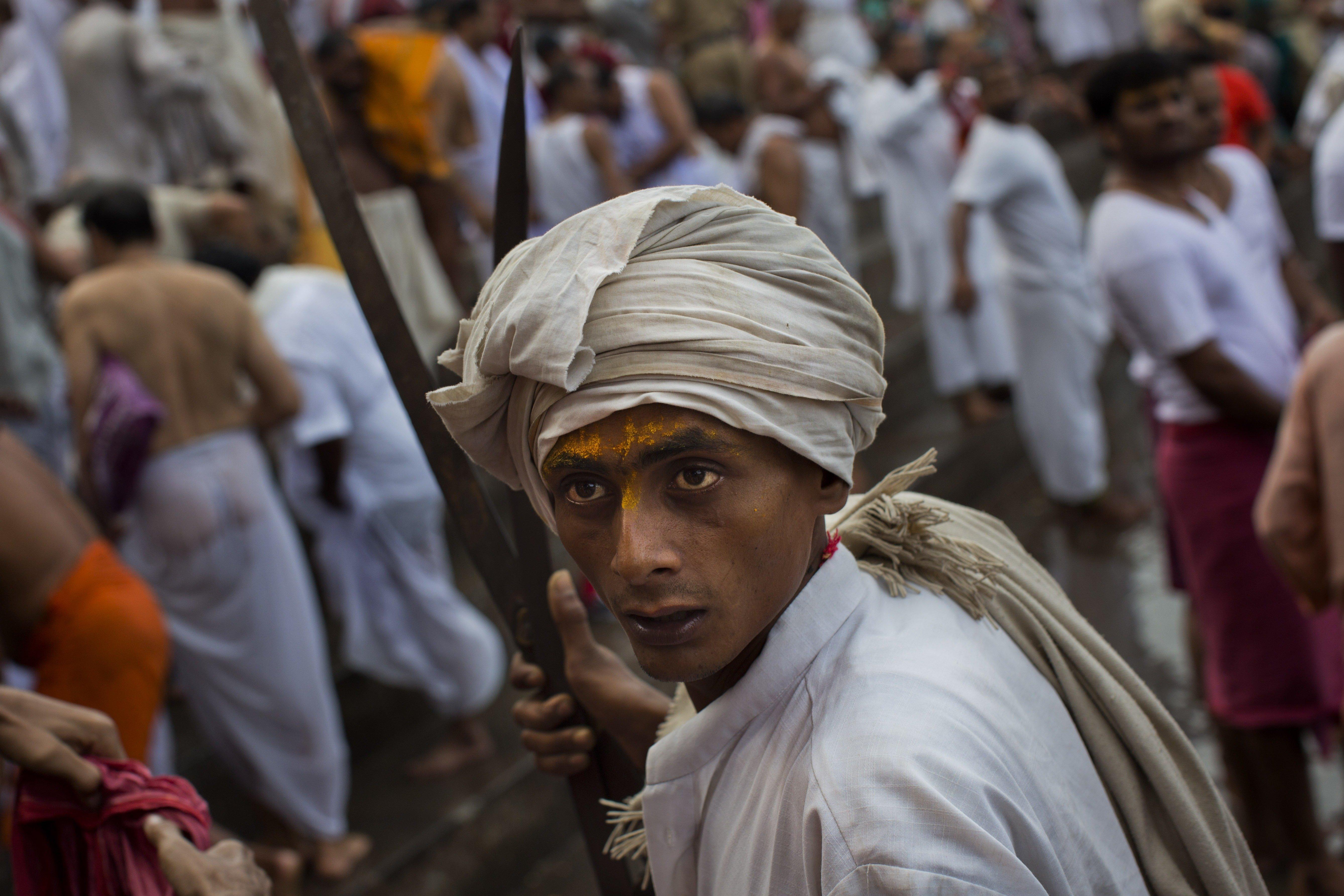 An Hindu devotee prior taking a bath the Godavari River during Kumbh Mela in Nasik, India, on Aug. 29, 2015.