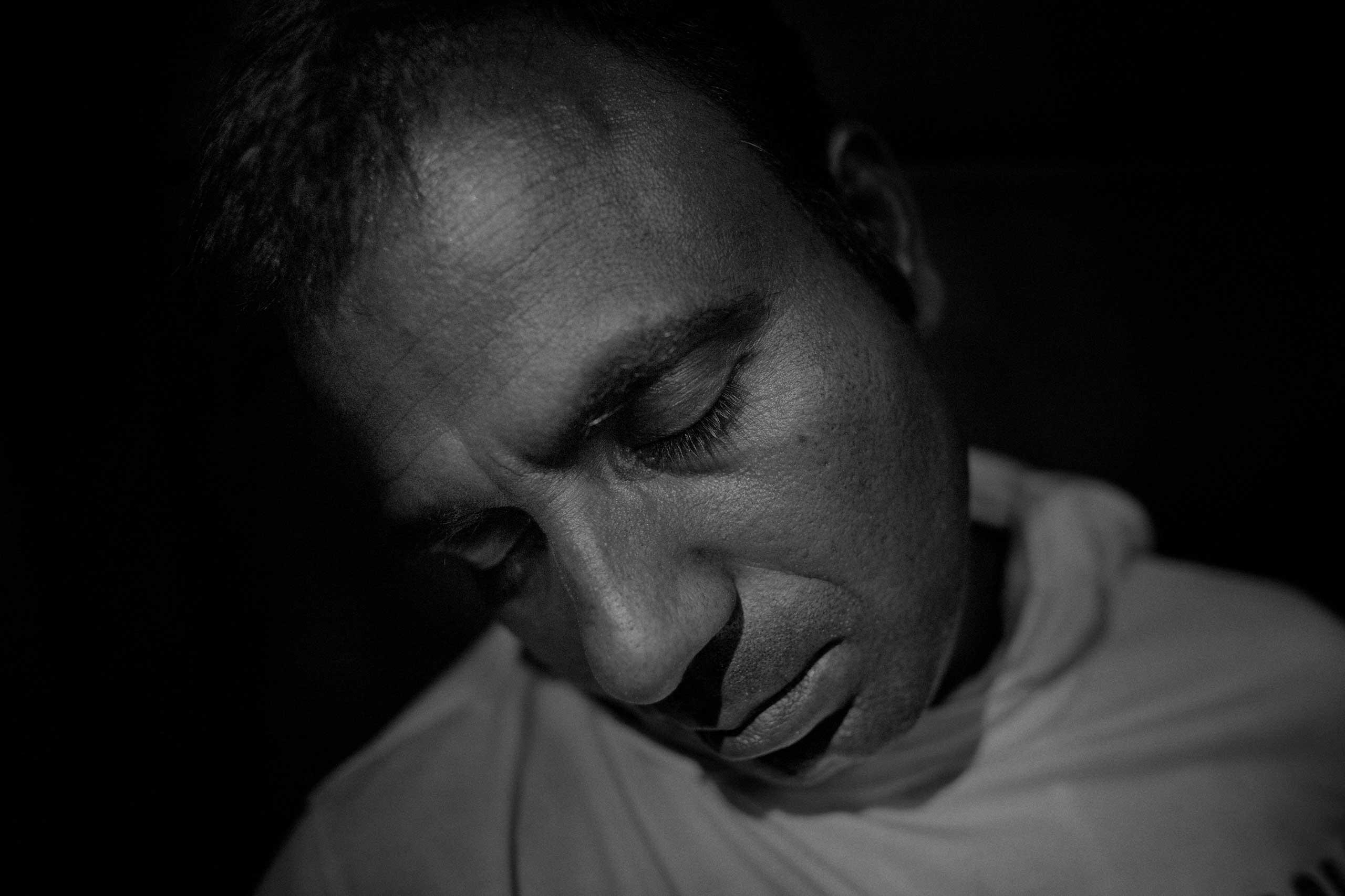 A man from Bangladesh sleeps on the local train, traveling from Gevdelija on the Macedonian-Greek border, to Tabanovce, on the Macedonian-Serbian border.